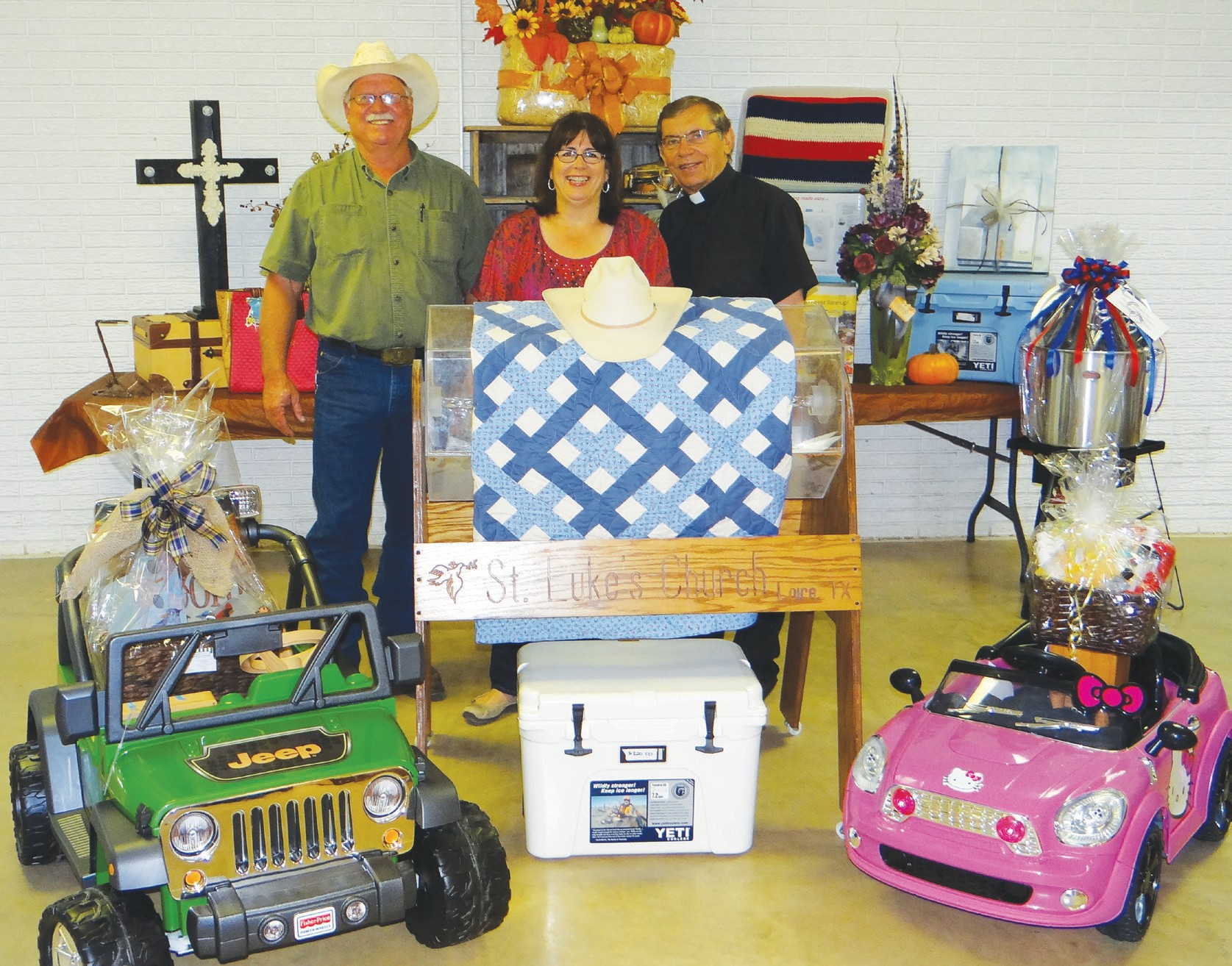 Father Stefan Wiera (right) is joined by parishioners Bill and Gail Slomchinski with items that will be featured in St. Lukes-Loire Catholic Church Fall Festival this Sunday, October 5. The barbecue and sausage dinner will be served from 11 a.m. until 2 p.m. Lots of family fun is planned, plus polka music and auction.