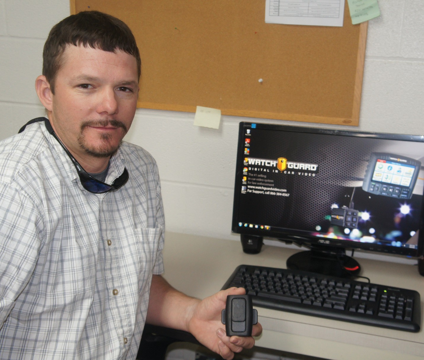 Bruce Hickman, City of Poteet Code Compliance Officer displays one of the body cameras used by the Poteet Police Department.