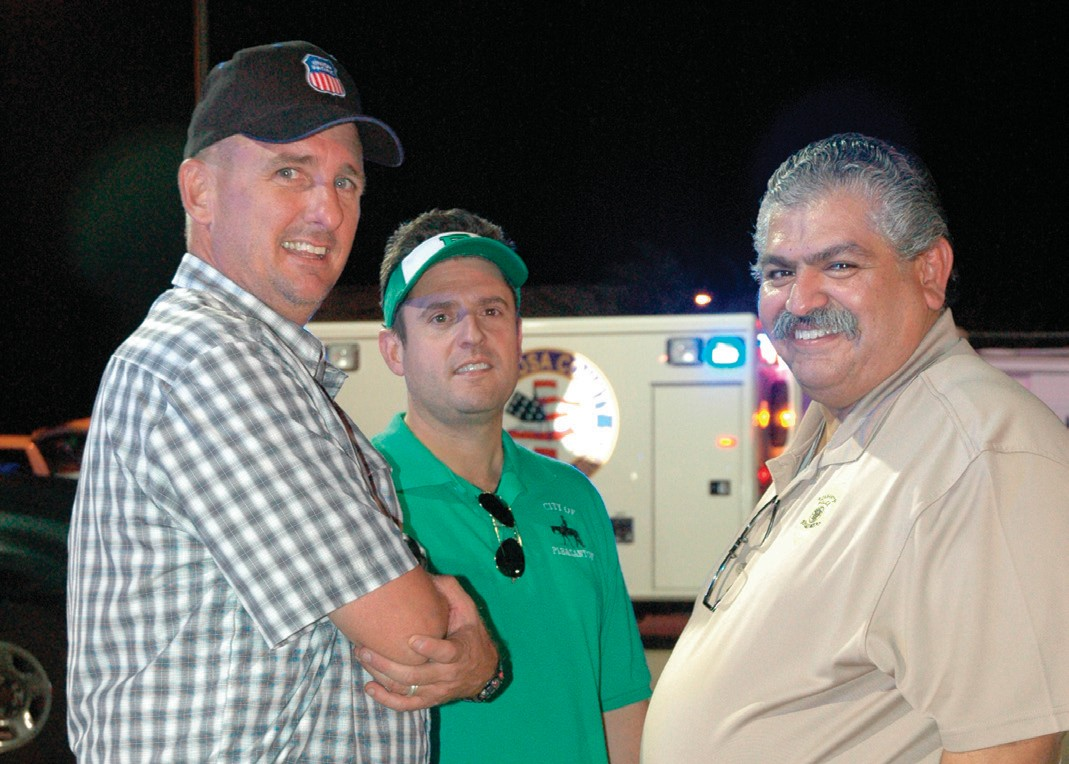 Louis Tudyk, Mayor Clint Powell and Chief Ronald Sanchez visit during the National Night Out event held Tuesday, October 7.