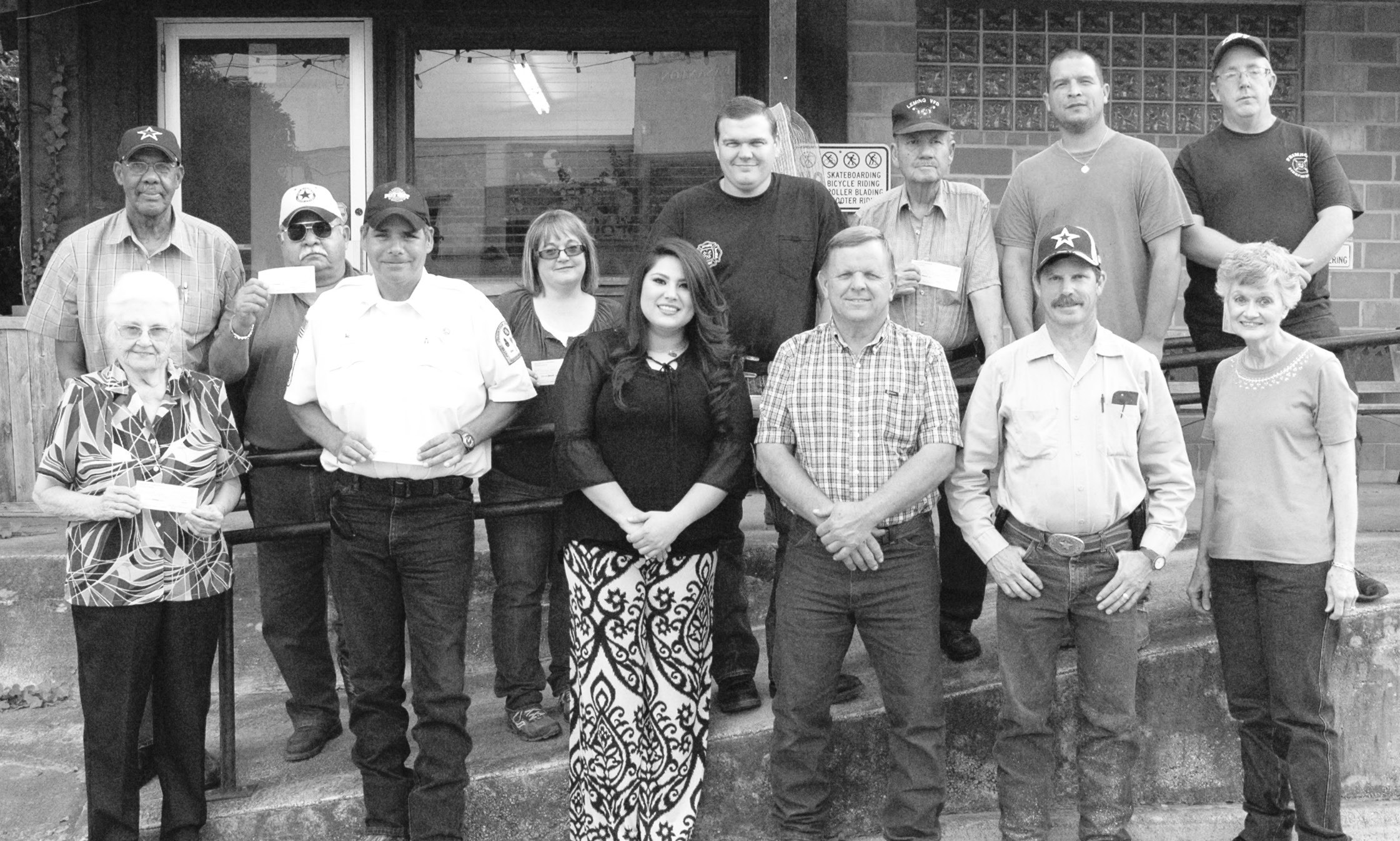"""RVOS Lodge 127 officers presented checks to various non-profits in Atascosa County. Left to right, back row: Rev. Junior Jones (Director Atascosa County Christian Assistance Ministry -CAM); Fire Chief Martin Llamas, Jr. (Campbellton """"Paisano"""" VFD); Jackie Jerkins (Treasurer Christine VFD); Jay Fojtik (Assistant Chief Jourdanton VFD); Juan R. Rodriguez (President Leming VFD); Junior Bosquez (1st. Assistant Chief Pleasanton VFD) and David Croft (Fire Chief Primrose VFD). Left to right, front row: Kitty Pesek (Steering Committee for Atascosa County Christmas Elf Project Target (ACCEPT); Rick Flores (President Poteet VFD); Stephanie Reyes (Vice President Rossville VFD); RVOS President Bobby Tymrak, RVOS Vice President John R. Muckleroy and RVOS Secretary Bettie House. Not pictured are RVOS sales agents Janice Favor and Cheryl Henry and representatives from Atascosa County Crime Stoppers, Charlotte VFD, Jarret VFD, Lytle VFD and Somerset VFD."""