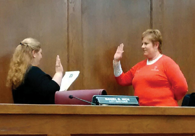 Jourdanton Municipal Court Judge Dolores Cordova administers the oath of office to Jourdanton Mayor Susan Netardus at Mondays' council meeting.