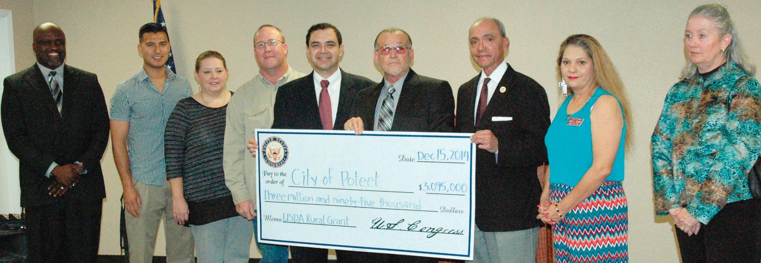 Congressman Henry Cuellar (D-TX28), presented a check of over $3 million from the USDA to the City of Poteet on Monday. Left to right are: City Administrator Scott Moore, Poteet Council Members Sonny Estrada, Vanessa Saylor, Greg Groesbeck, Congressman Cuellar, Poteet Mayor Larry Cantu, USDAState Director Paco Valentin, Council Member Denise Sanchez and Atascosa County Judge Diana Bautista. Not pictured is Council Member Valerie Reyes Hernandez.