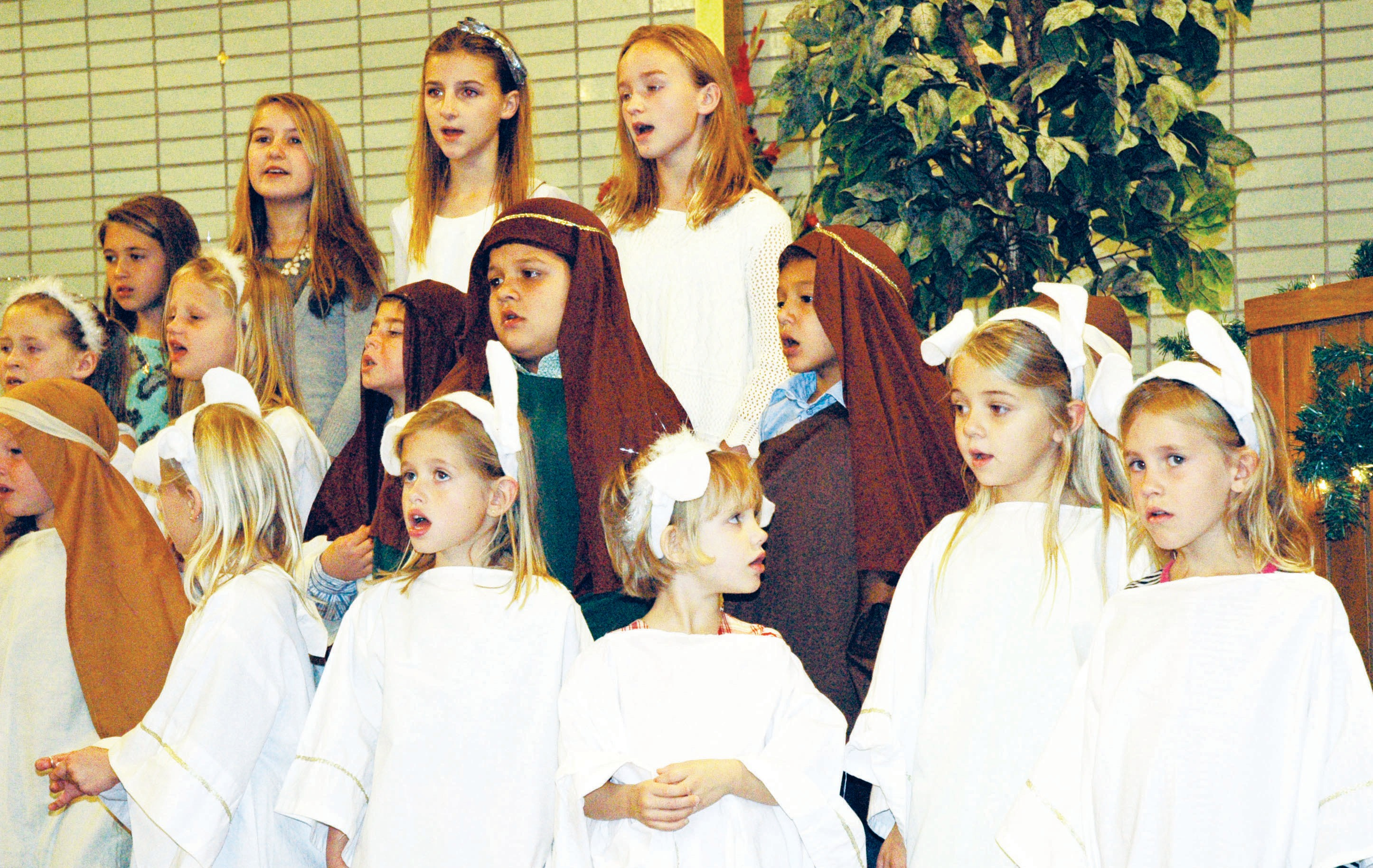 Cast members of First United Methodist Church Christmas play sing the final song. Left to right on the top row are: Brooke Rankin, Lauren Trapp, Brandi Barnett and Kinley Graf. Middle row: Natalie Read, Katie David, Koel Campbell, Evan Guajardo and Marcos Guajardo. Bottom row: Drew David, Sara Clark, Presley Moos, Ella David, Preslie Miller, Ryan Brymer and Kael Campbell. The youth of the church led the congregation on Youth Sunday, December 7.