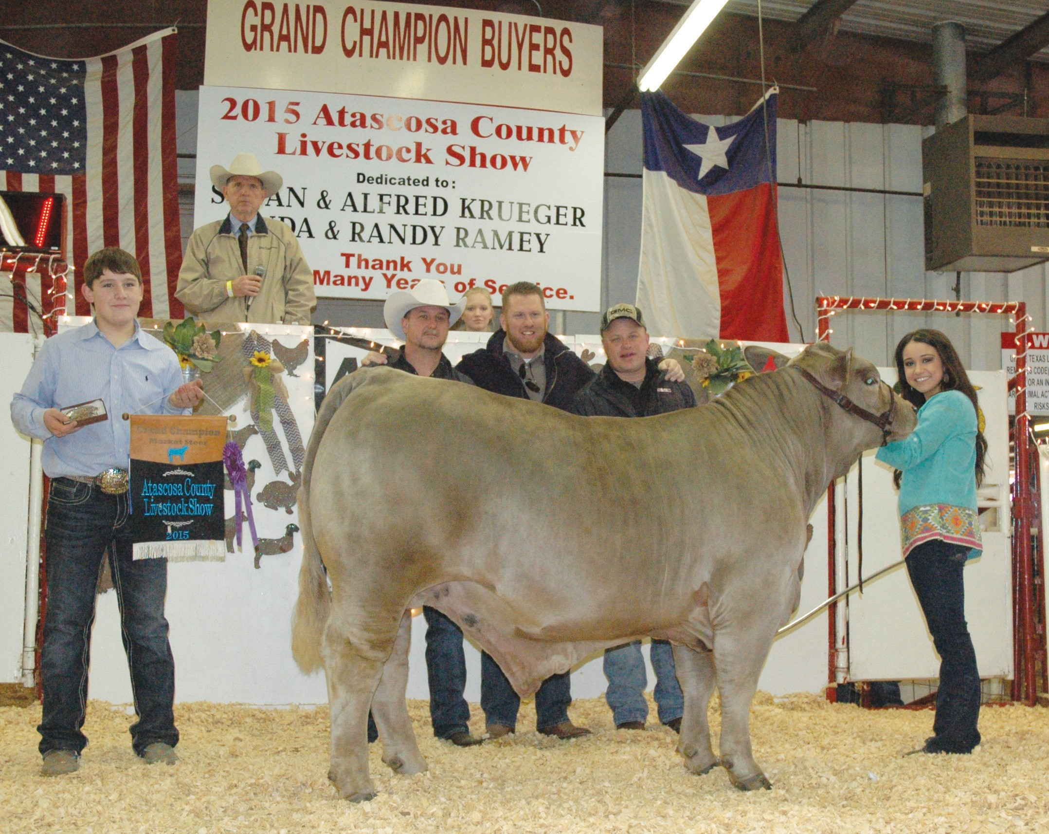 Tatum Bauer, right, is pictured with her Grand Champion Steer. The Heavy Weight ABC was sold to buyers Pursch Motors, Inc. and Mac Haik's Southway Ford for $8,000. Pictured left to right, Hunter Norment (with banner and buckle) Edward Dove and Tim Swan with Mac Haik's Southway Ford and Chris Morlock with Pursch Motors, Inc.