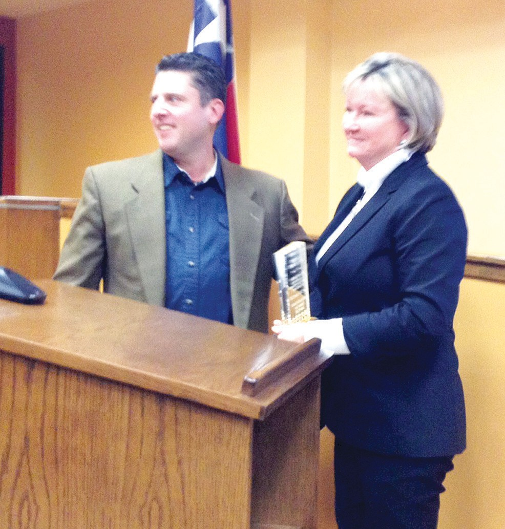 Dr. Cynthia Clinesmith receives a plaque of appreciation from Mayor Clint Powell, council and staff for her dedication and leadership for Pleasanton ISD and her involvement in the community.