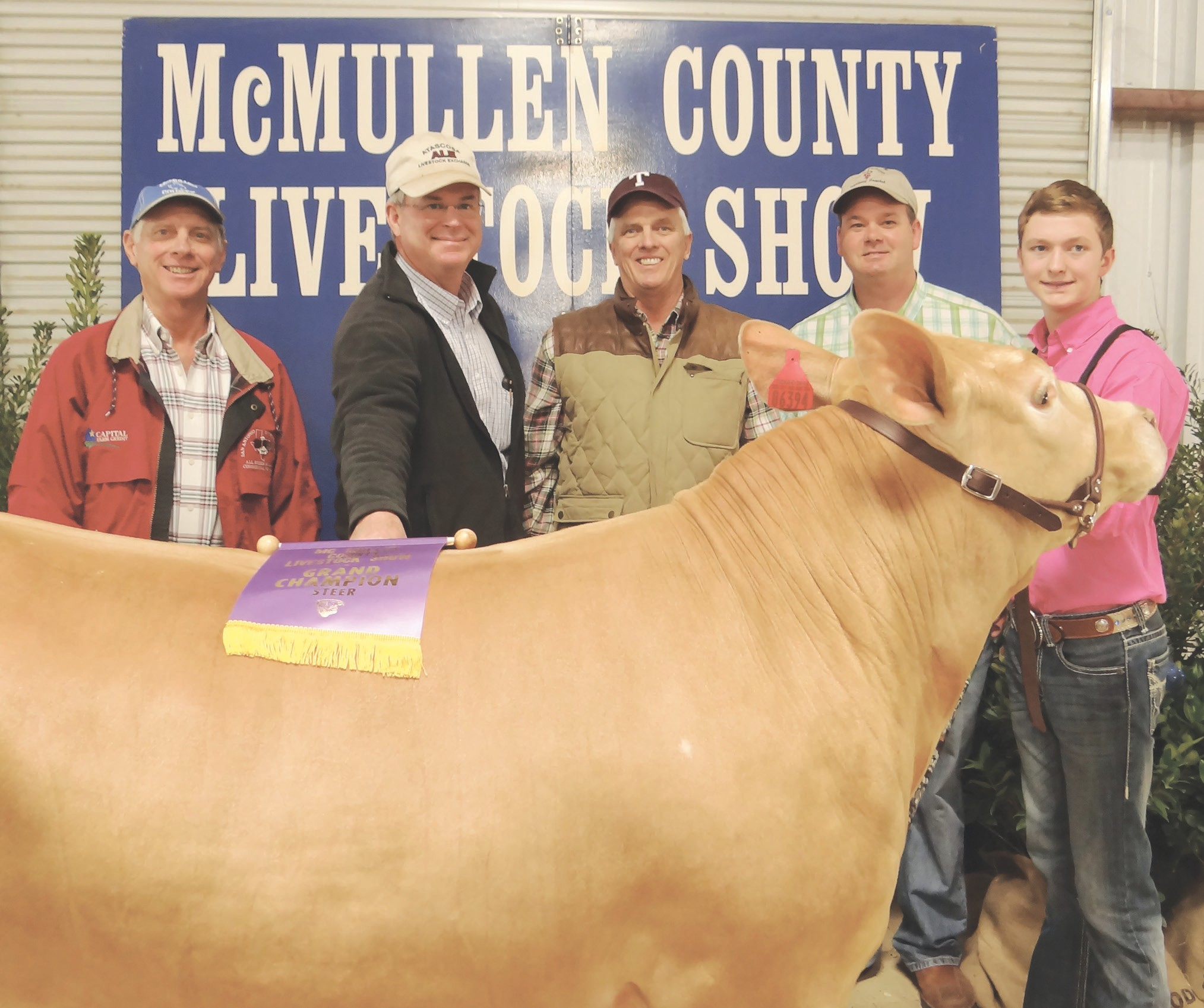 The McMullen County Livestock Show Grand Champion Steer was shown by Colton McCartney (right). The steer sold for $15,000 to (left to right) Marty Harris, San Miguel Syndicate; Jim Wheeler, Atascosa Livestock Exchange; Walt Franklin, Atascosa Syndicate and Dave Underwood, School House Syndicate.