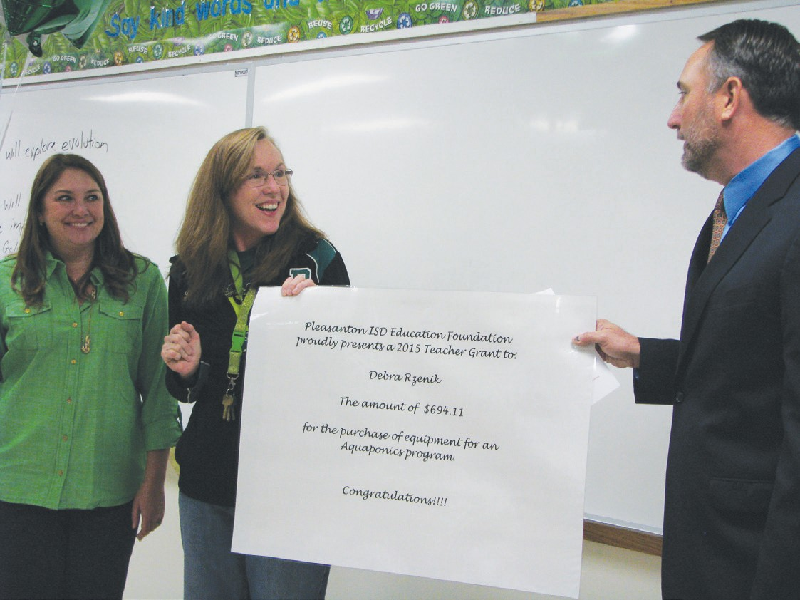 Pleasanton High School biology teacher Debra Reznik will use her grant, totaling $694.11 to fund an auquaponic project. Foundation president Carey Troell (right) and Kelli Powell, Foundation board member assist in the presentation.