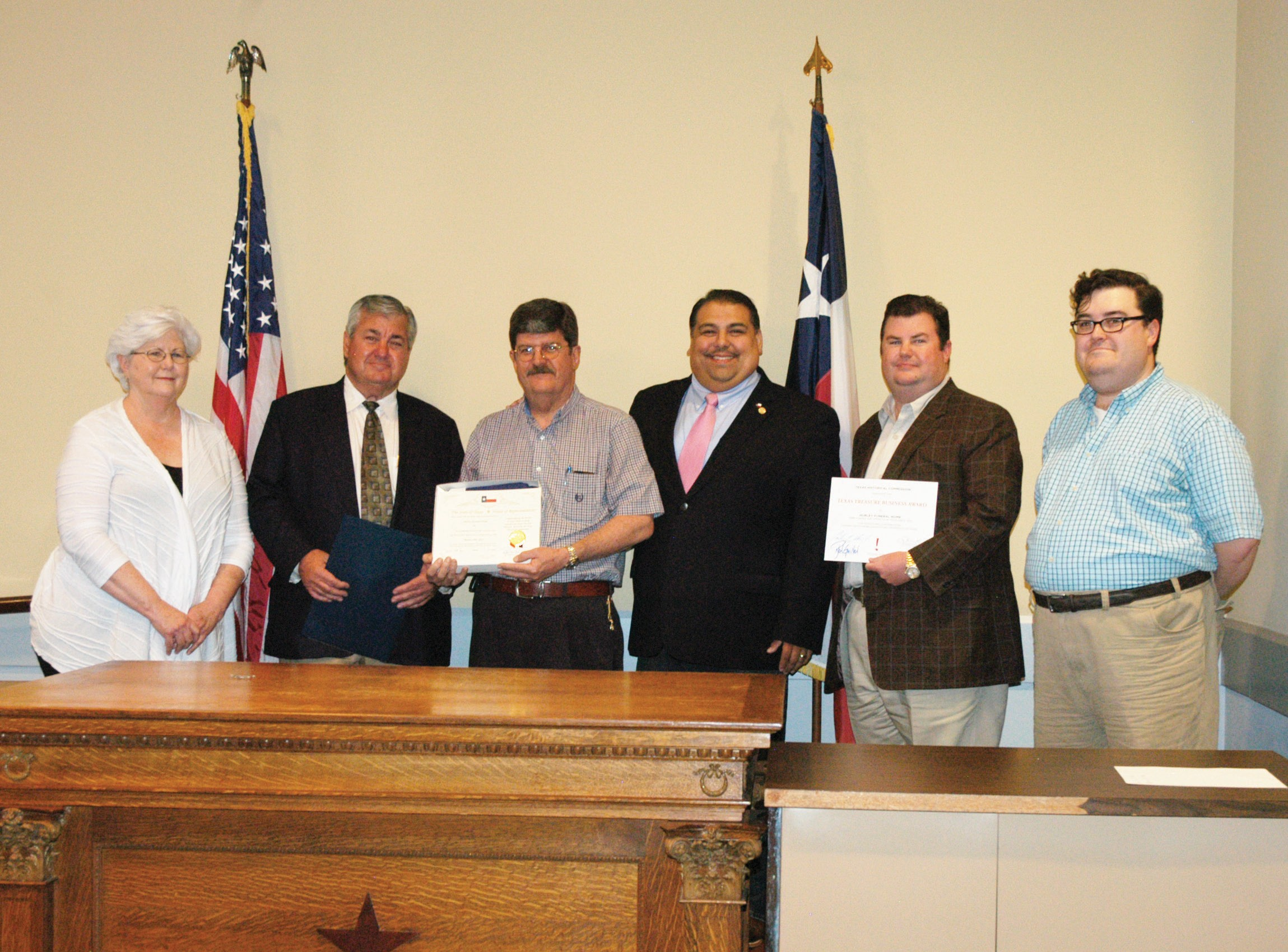 Hurley Funeral Home was awarded a Texas Treasure Business Award on Thursday, March 19, at the courthouse. Left to right are: Barbara Westbrook, Atascosa County Historical Commission Chairman; Pat Hurley, Ross Hurley, Texas State Representative Ryan Guillen, Patrick Hurley Jr, and Evan Hurley. The family received a certificate and a flag that was flown over the Capitol earlier that day.