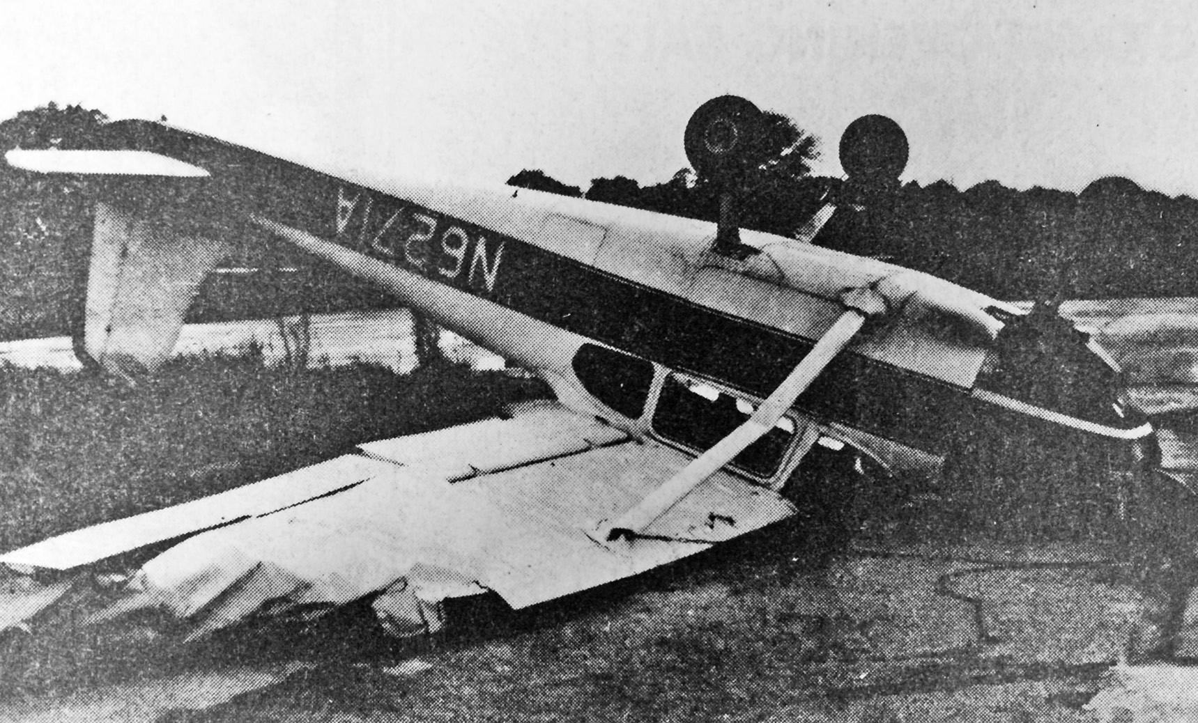 FLIP FLOP-Pictured is one of the damaged airplanes from the local airport, after Sunday afternoons high winds and gusting rains. Damage is estimated at $1,000. Express photo originally ran in May, 1975.