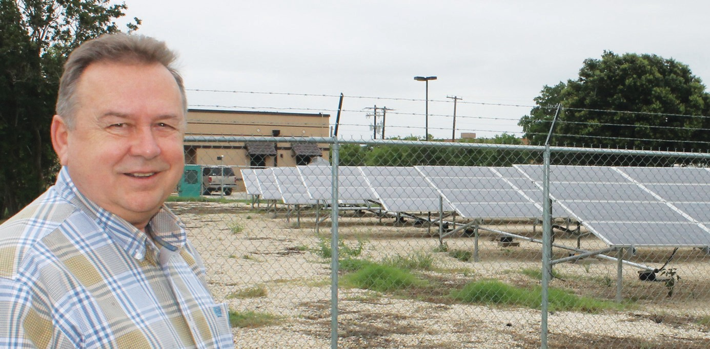 Jourdanton City Manager Dan Nick, standing near a setup of almost 600 solar panels located behind the new, beautiful Jourdanton City Hall. The panels produce enough electricity to handle a significant amount of the city hall complex and excess is sold to Karnes Electric Coop.