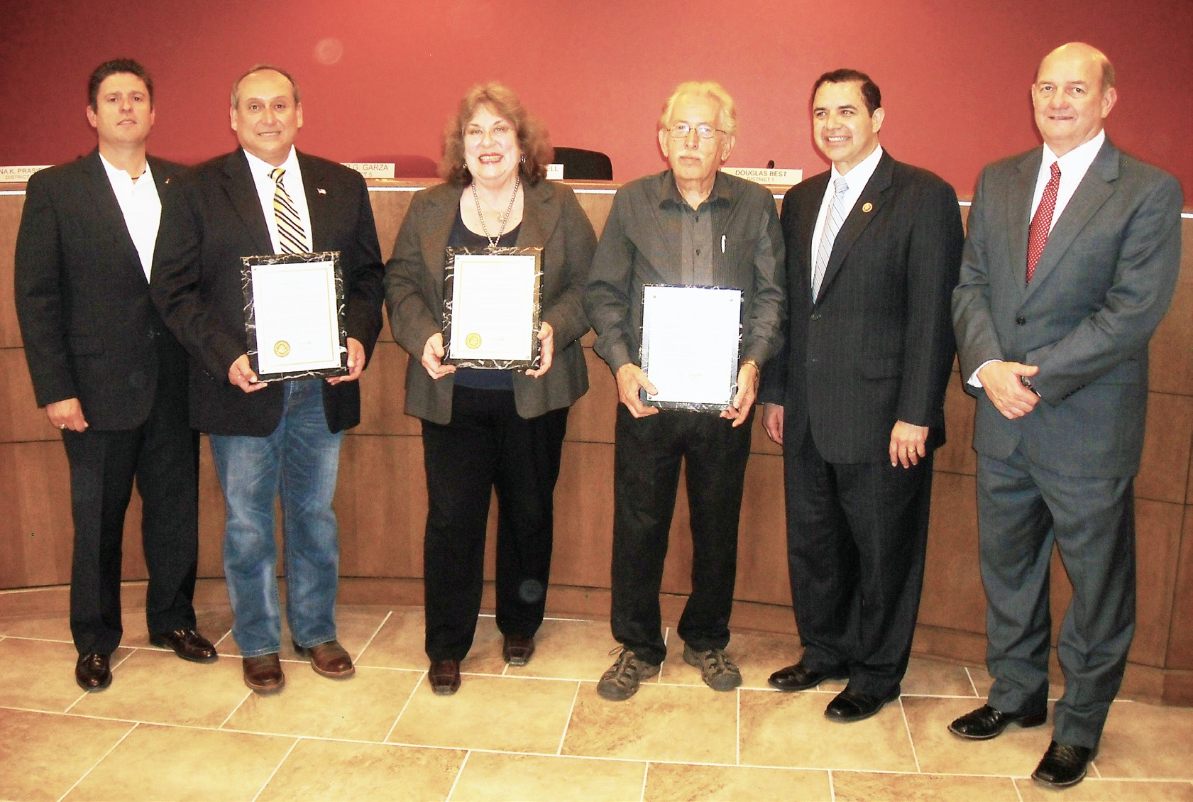 U. S. Congressman Henry Cuellar (second from right) gave specia lCongressional Recognition to three outgoing Pleasanton City Councilmembers - Roger G. Garza (18 years), Jeanne Israel (6 years) and J.R. Gallegos (23 years) on Monday, May 11. Dr. Cuellar presented three plaques and read each personalized message for each member. Dr. Cuellar stressed to those in attendance that this will forever be in the Congressional Record. Cuellar read the recognitions on the U. S. House of Representatives floor on March 25, 2015.
