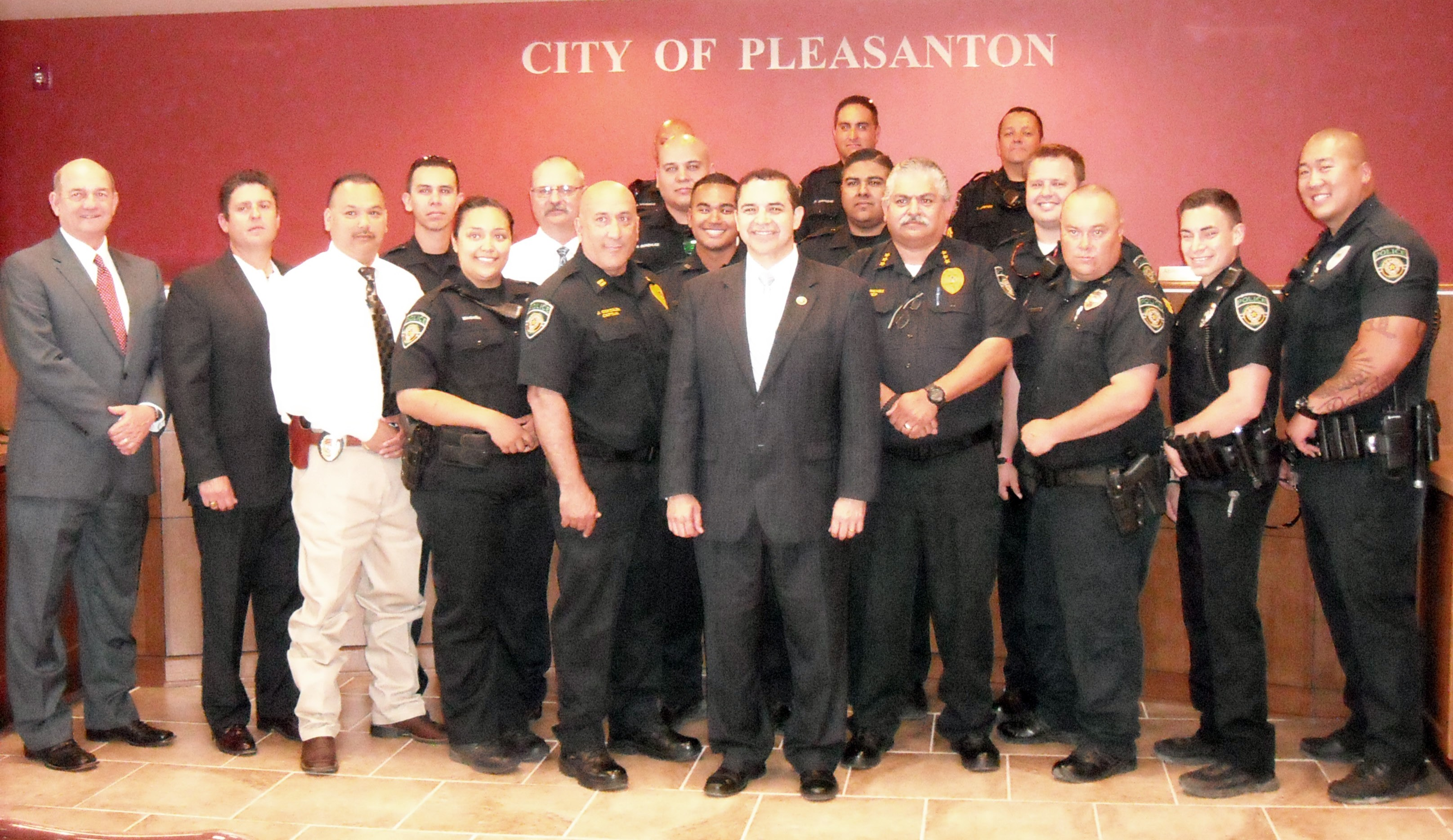U.S. Congressman Henry Cuellar (center) visited with the Pleasanton Police Department while he was in town on Monday, May 11. He acknowledged the Pleasanton Police Department during National Police Week, commending them on a job well done. Back Row: Officer Damian Balderas, Officer Daniel Zertuche and Sgt. David Jimenez. Middle Row: Officer Anastacio Perez, Lt. Jimmie Cole, Officer Anthony Gonzalez, Officer Justin Granado and Sgt. Pierce Ruple. Front Row: City Manager Bruce Pearson, Mayor Clinton J. Powell, Lt. Ernest Guerra, Officer Mari Magana, Captain Johnny Gonzales, Officer Kai Viesca, Chief Ronald Sanchez, Officer Jordan Haren, Officer Andre Vargas, Officer Tzu-Chi Chia