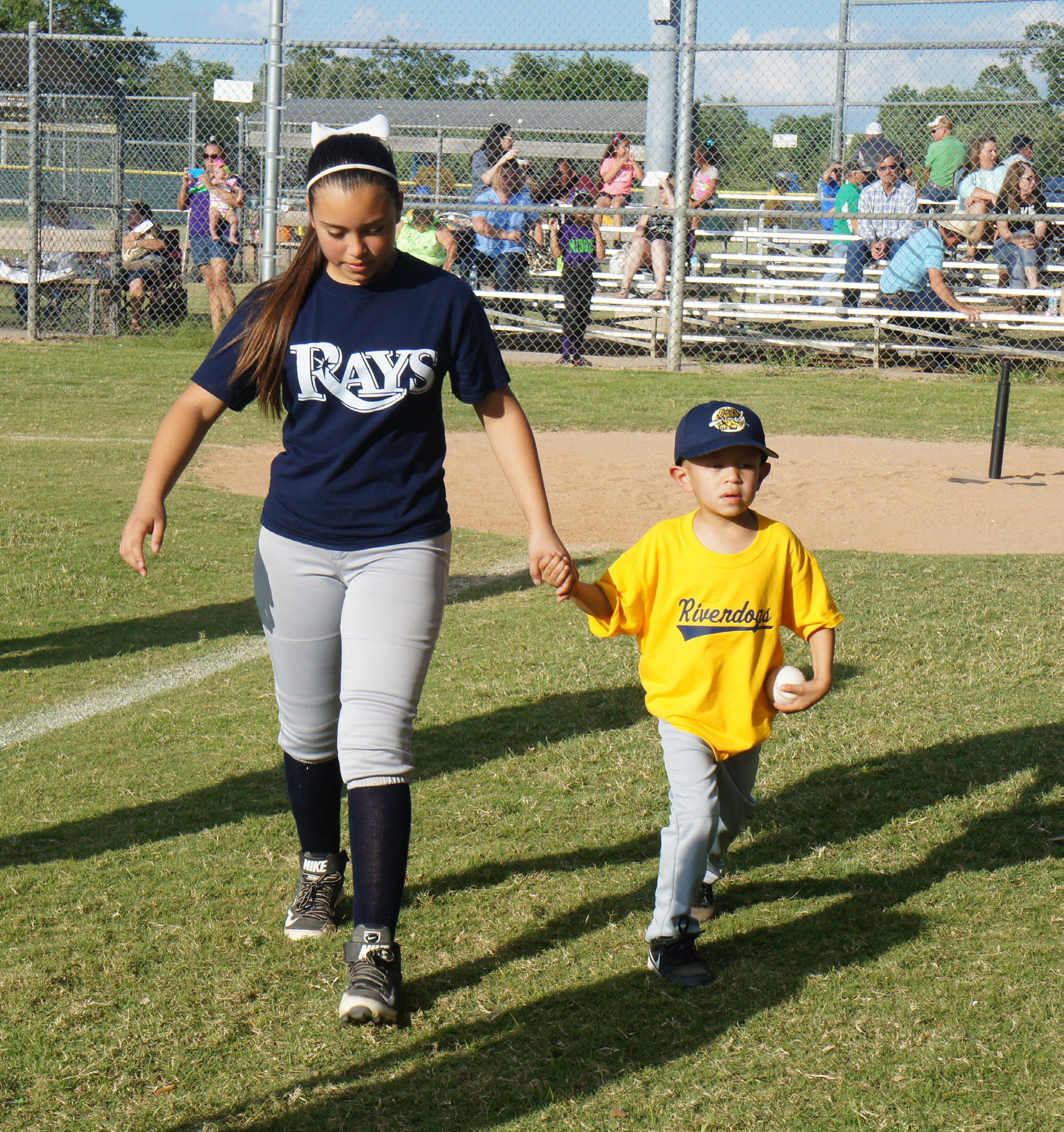 Jessie James Sandoval finishes racing around the bases with his sister, Leanna Alcorta, by his side. The 5-yearold has embroyonal rhabdomyosarcoma and had a wish to play T-ball.