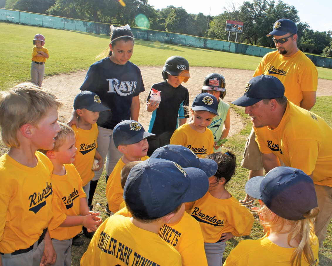 Riverdogs Coach John Olle congratulates the team after Jessie James Sandoval played his first T-ball game.