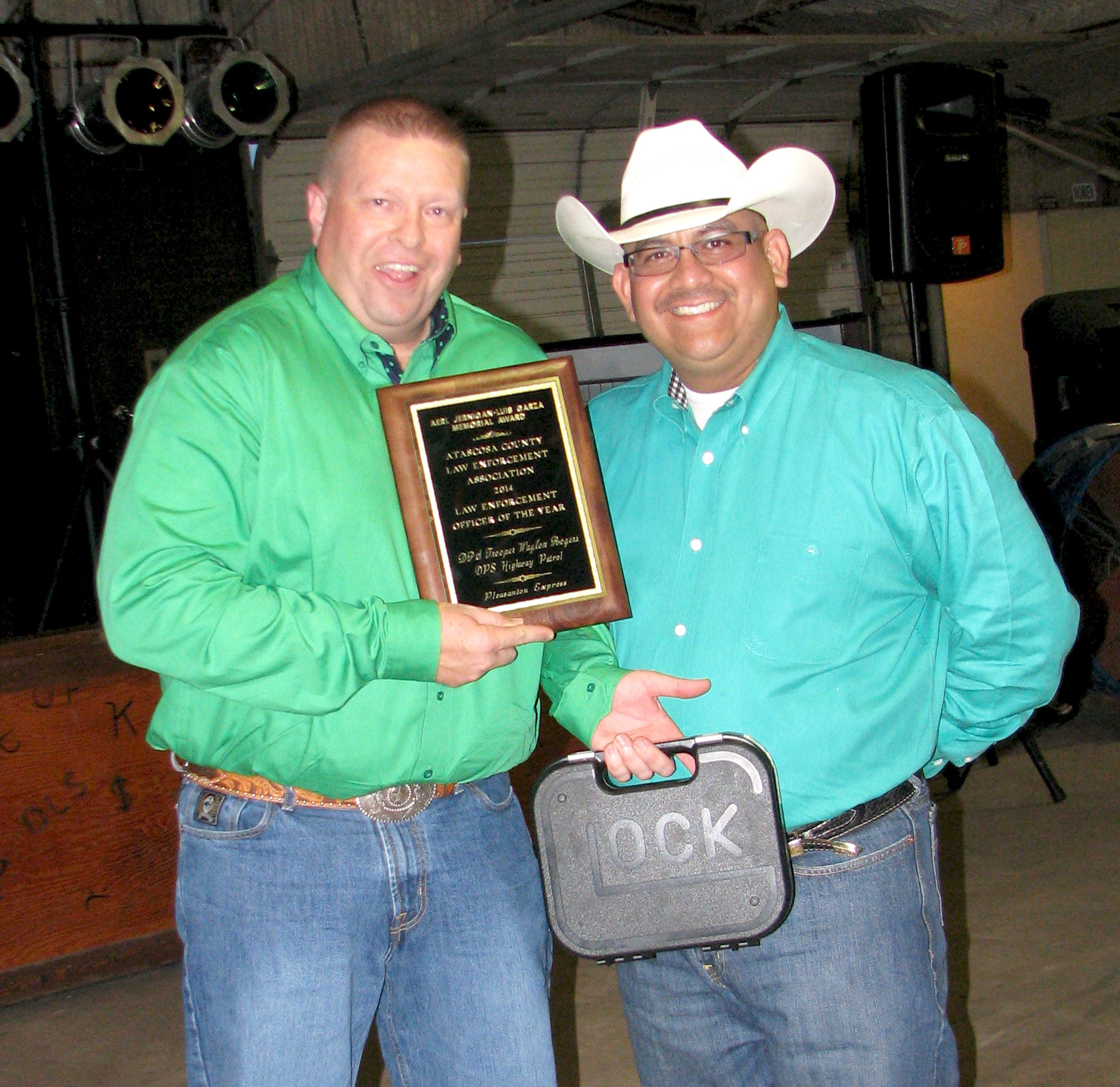 DPS Trooper Waylon Rogers, left, received the 2014 Atascosa County Law Enforcement Officer Association Officer of the Year award, sponsored by the Pleasanton Express and a Glock .40 pistol from ACELOA presented by President Albert Garza.
