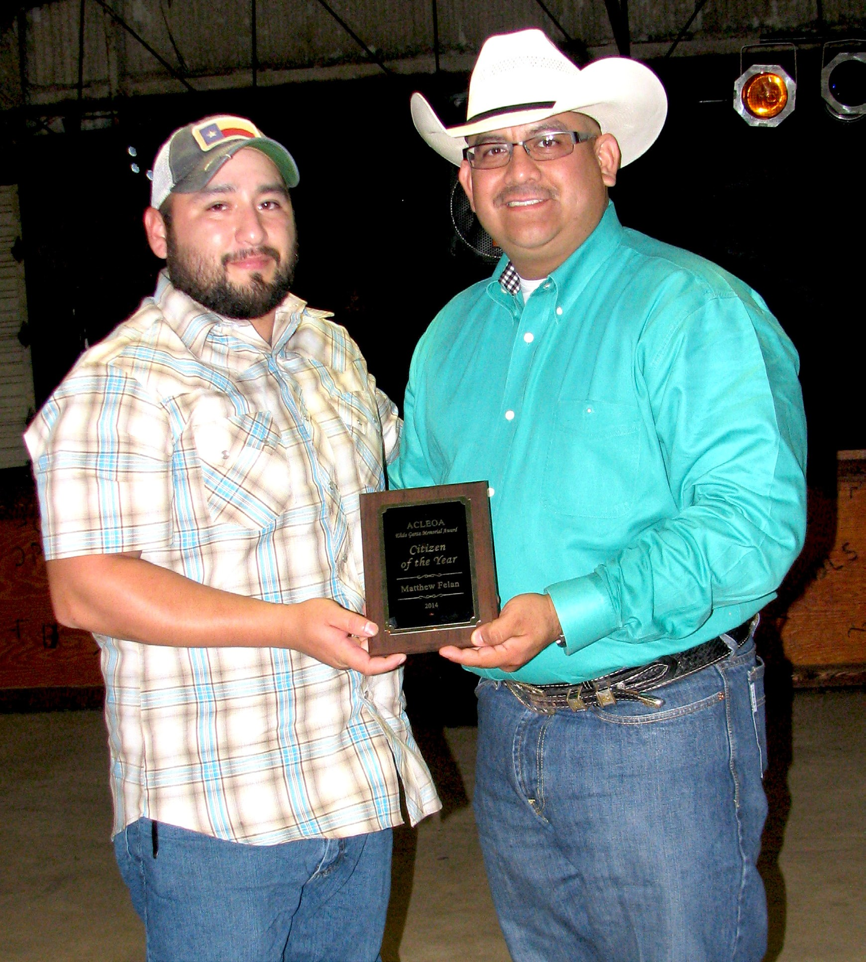 Matthew Felan (left) was awarded the Citizen of the Year at the annual Atascosa County Law Enforcement Officer Association banquet held Saturday, June 13. ACLEOA President Albert Garza presented the plaque of appreciation.
