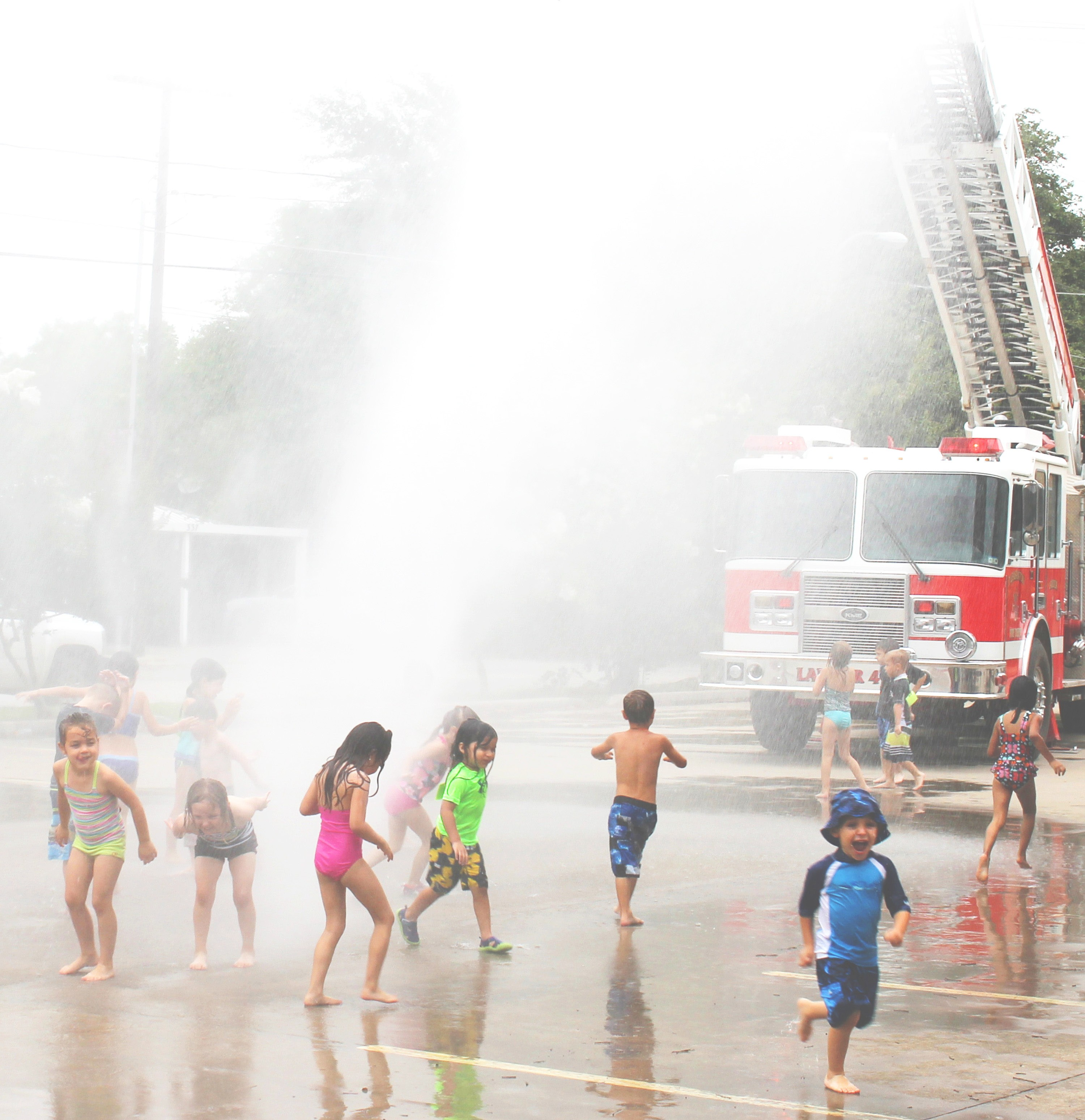 Kiddos at First Baptist Church Child Development had a treat from the Pleasanton Fire Department last week for Water Play Day. The fire engine helped to spray and soak the tykes so they could cool off during the hot summer's day.