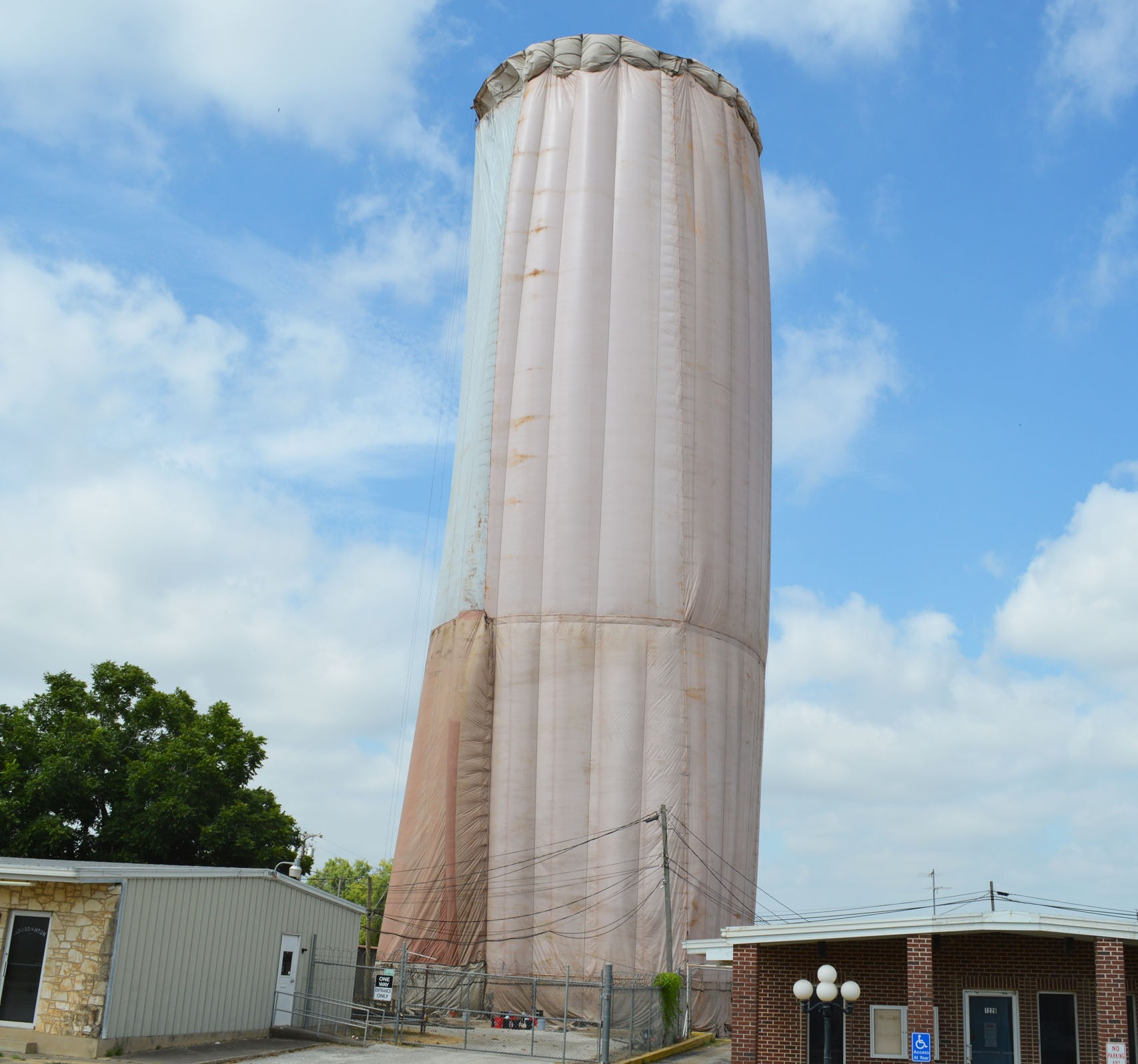 The water tower in Jourdanton is getting a facelift. It is cloaked during the sandblasting - inside and out - and a new exterior paint job will be performed as well. The projecto started two weeks ago and should be completed sometime in September. The maintenance is part of a $400,000 grant that the city received. A bonus - new LED lights will adorn the cat walk around the tank to promote winning results of JISD UIL varsity events.