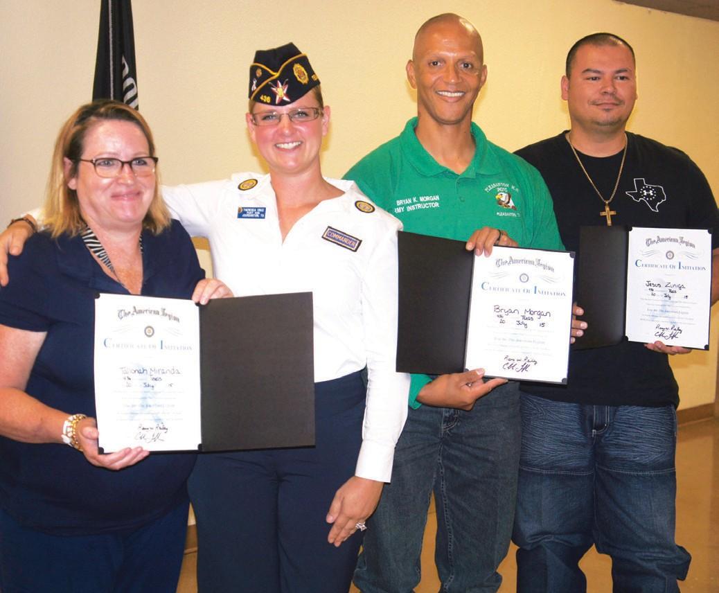 Theresea Cruz presented certificates to new members Tallonah Miranda (far left), Bryan Morgan and Jesus Zuniga. American Legion Post 436 Commander Theresea Cruz and husband Isaias Cruz.