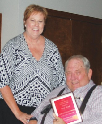 Sandy Steinle receives his Lifetime Achievement Award from Susan Netardus at the Jourdanton Chamber banquet.