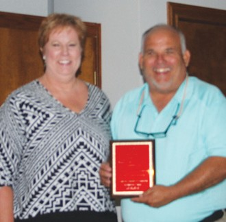 "Robert ""Doc"" Williams was named Jourdanton Chamber's Man of the Year at the annual banquet. Susan Netardus made the presentation."