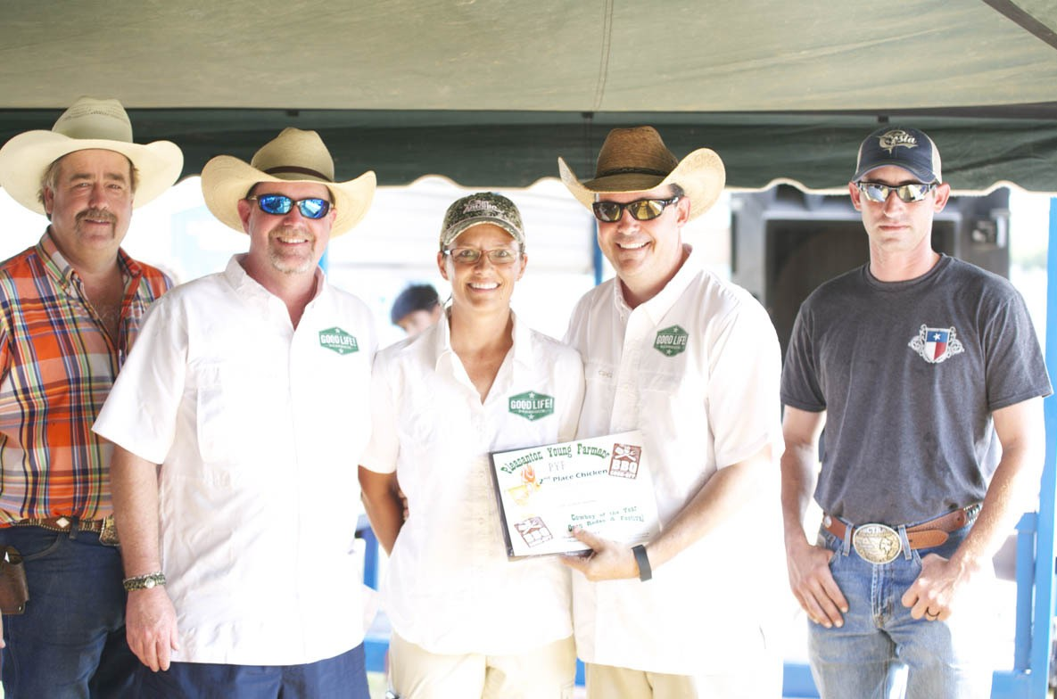 PYF 2ND PLACE CHICKEN The Good Life BBQ, Matt Wheat, Heather Swindall and Clint Swindall took second place with their barbeque chicken. PYF Chair Randy Rice (left) and Dustin Neal (right) congratulate the team.