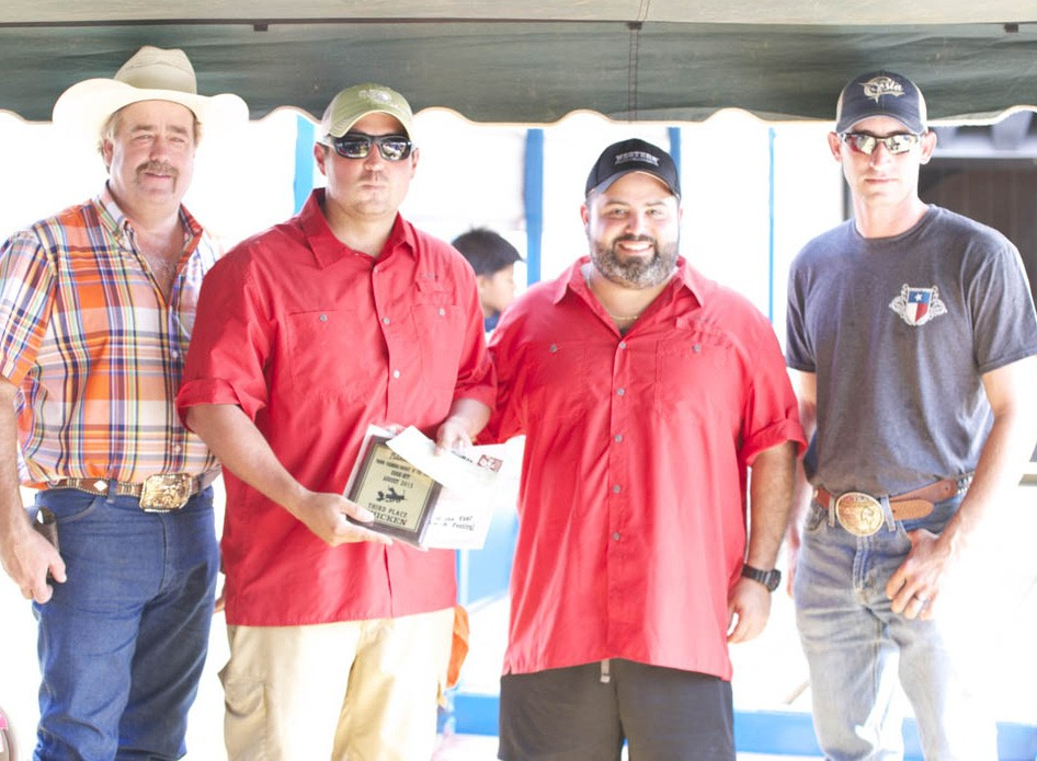 PYF 3RD PLACE CHICKEN Winning third place in the chicken category were C&E Cookers Chris Hilliard and Eddie DeLeon (center). PYF Chair Randy Rice and PYF President Dustin Neal presented their plaque.