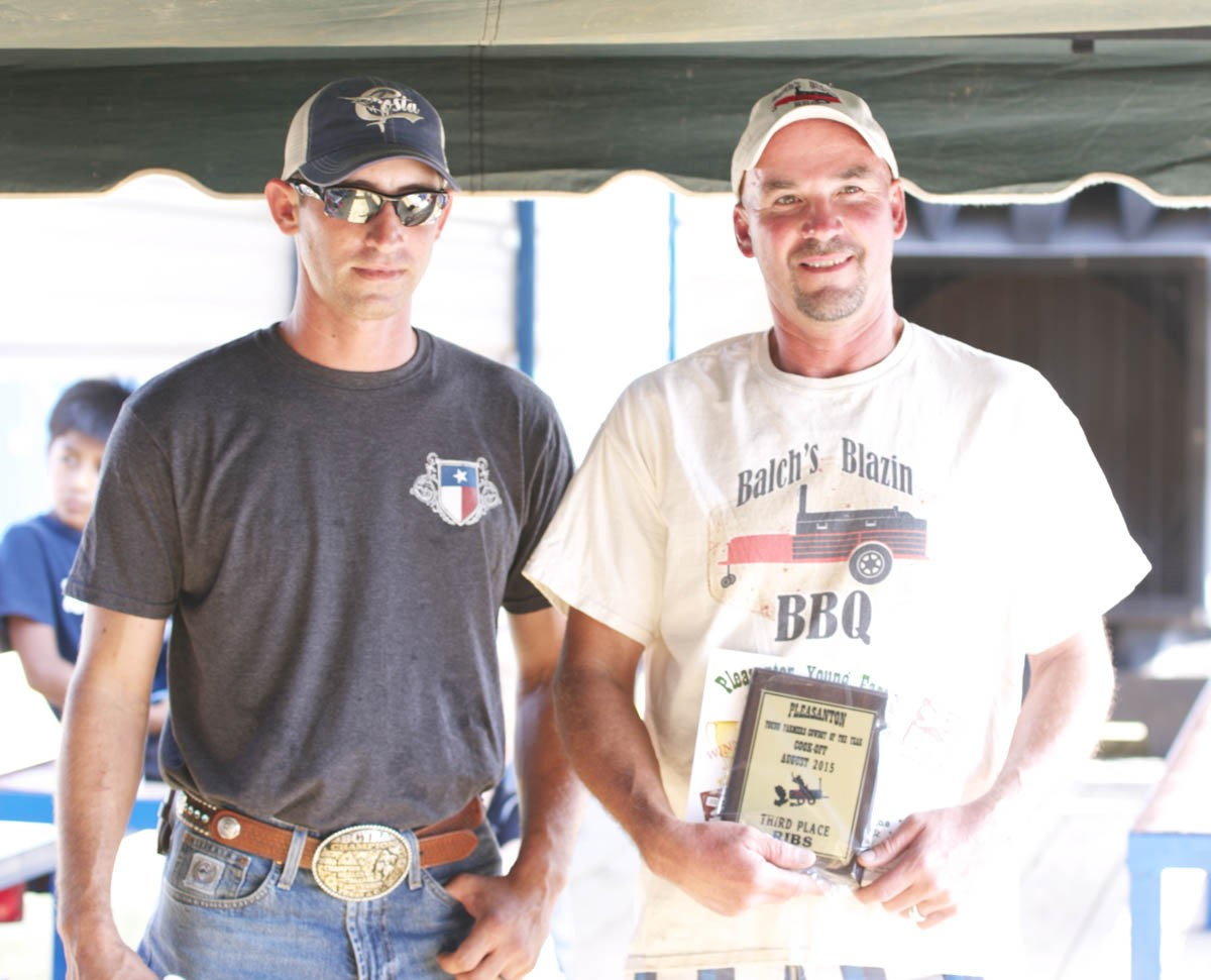 PYF 3RD PLACE RIBS Balch's Blazin' BBQ's Tim Balch (right) won third place with his pork spare rib entry. PYF President Dustin Neal presented him with his award.
