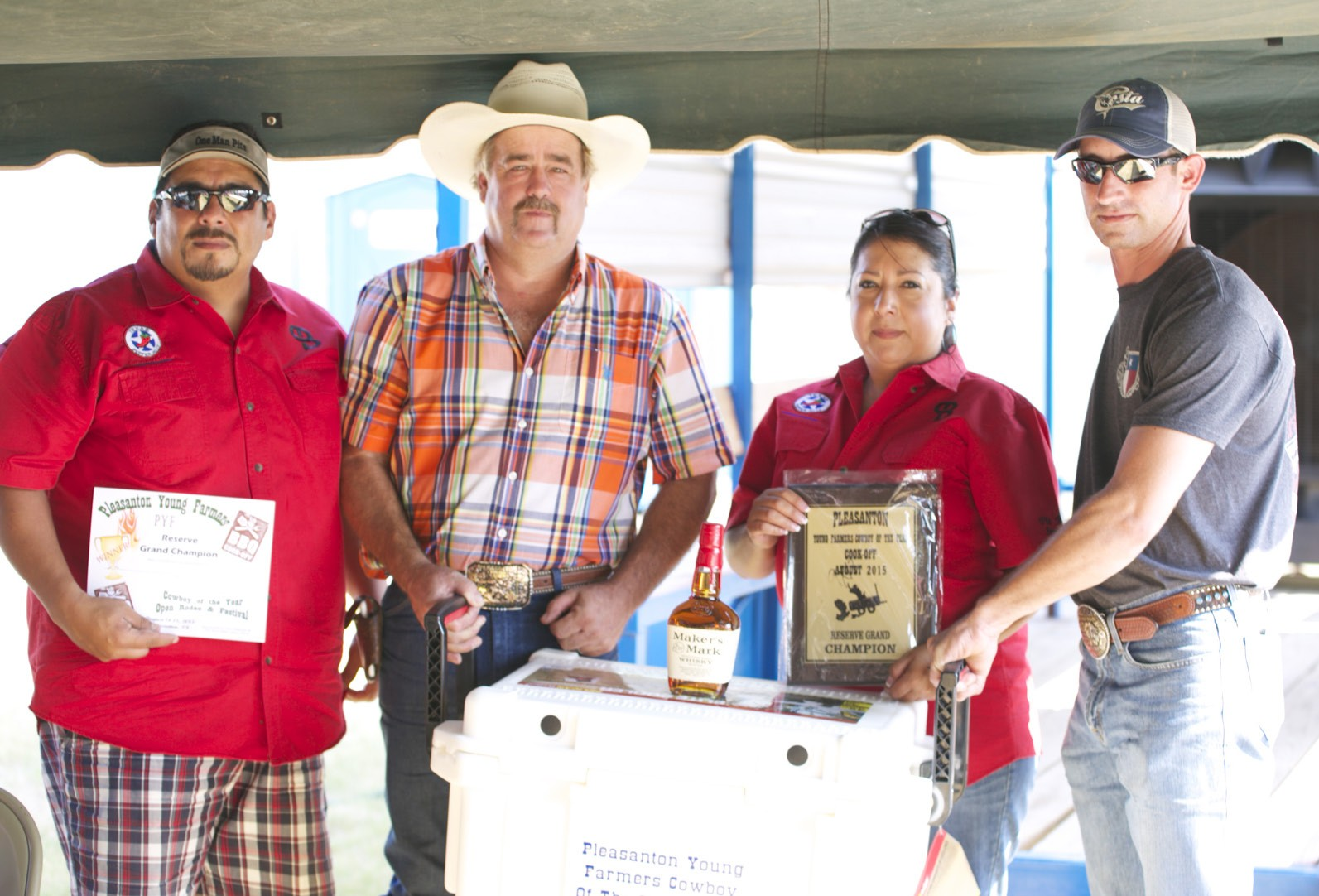 PYF RESERVE CHAMP BBQ Reserve Champion went to Pit Boss Smokers team of Matias Serrata and Maribel Cuellar (far left and second from right), PYF Chair Randy Rice and Dustine Neal. GEORGE GARZA | PLEASANTON EXPRESS