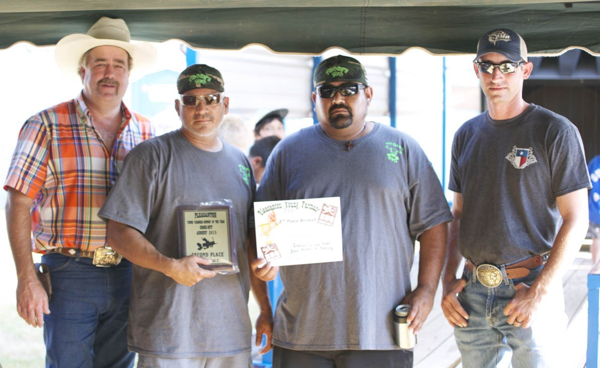 PYF 2ND PLACE BRISKET Winning second place in the brisket category were Smokin' 830's Andrew Garcia and Teddy Orta (center). PYF Chair Randy Rice and PYF President Dustin Neal presented their plaque. GEORGE GARZA | PLEASANTON EXPRESS