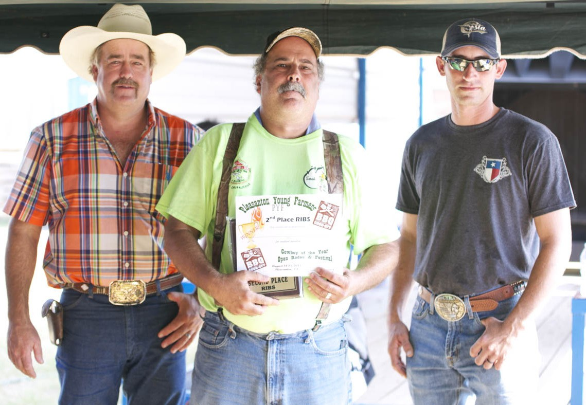 Winning second place in the pork spare rib category was Smokin' Rose's BBQ. Jim Simola (center)received his plaque from PYF Chair Randy Rice and PYF President Dustin Neal.