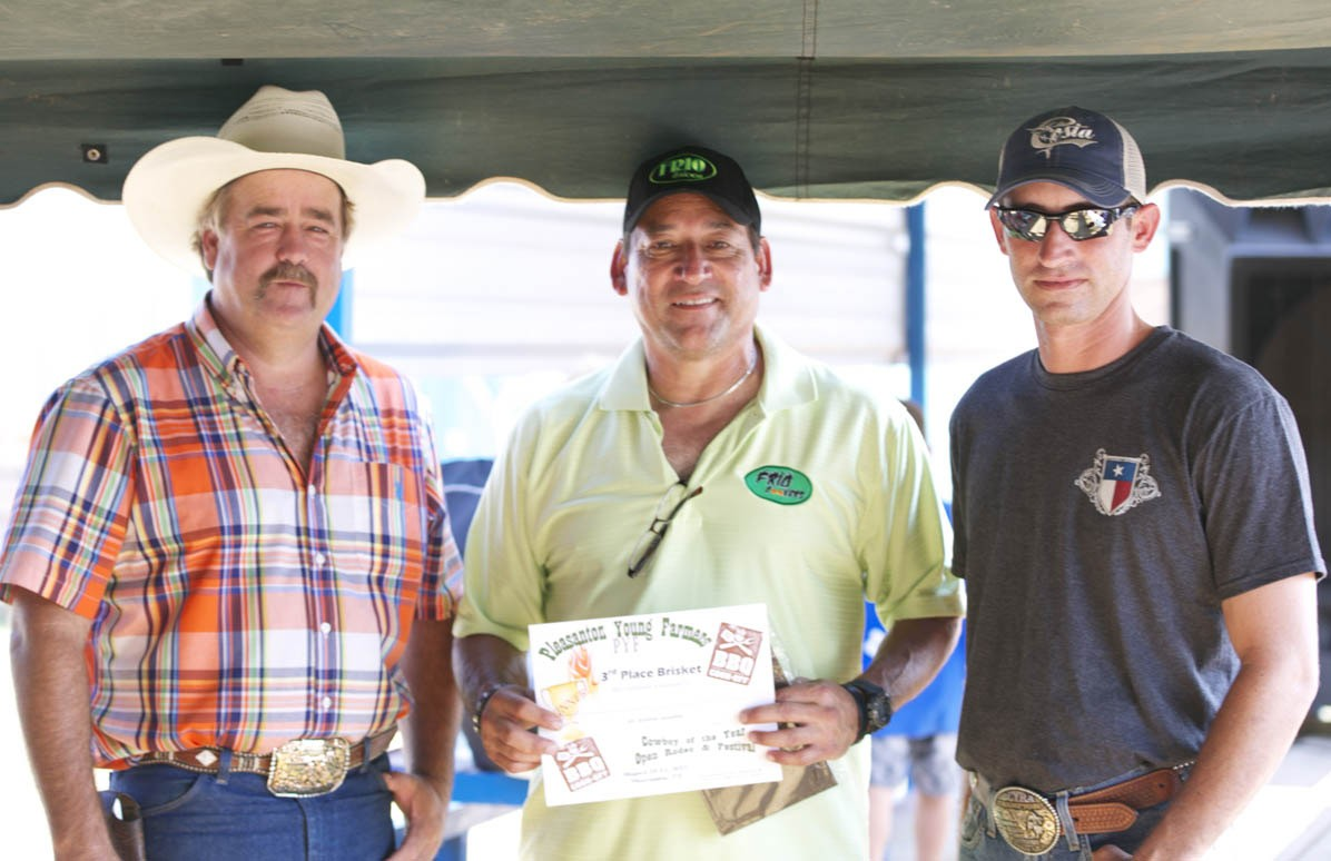 PYF 3RD PLACE BRISKET Frio Cookers' Anthony DeLaO (center) ) won third place with his brisket entry. PYF Chair Randy Rice and PYF President Dustin Neal present him with his award.