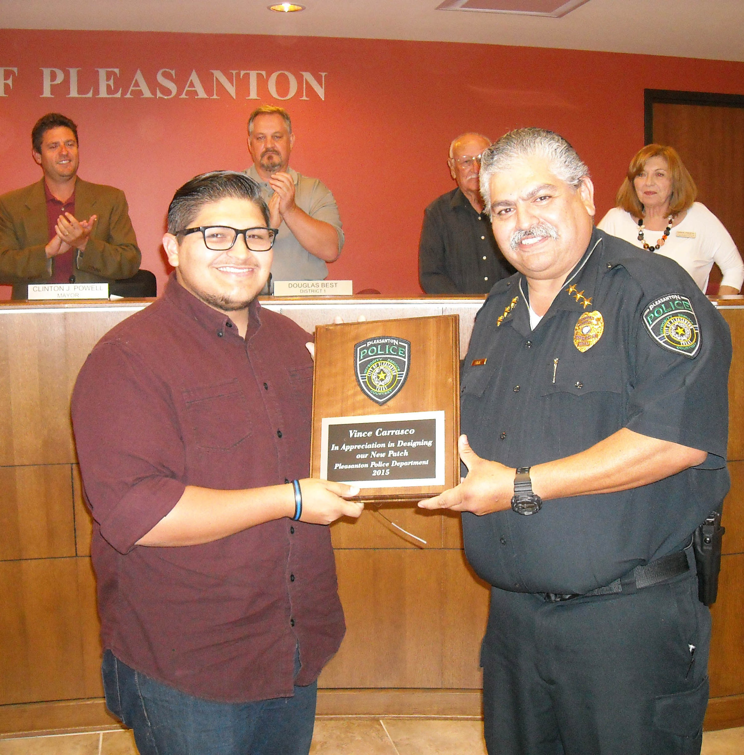 Vince Carrasco (left), son-in-law of Pleasanton Police Chief Ronald Sanchez (right), donated his time and talent and designed a new patch for the Pleasanton Police Department. He received a plaque of appreciation, embellished with his finished design during the August 6 Pleasanton City Council meeting.