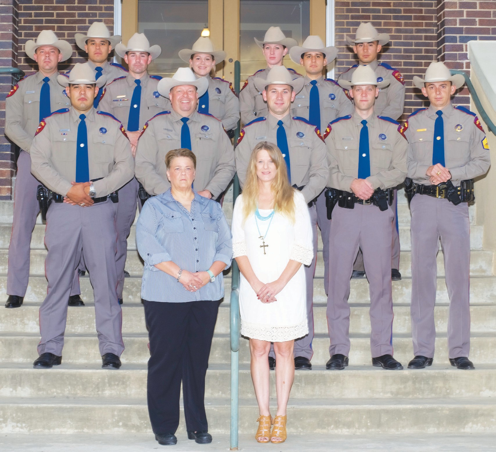 Gathering for a photo at the Atascosa County Courthouse in Jourdanton are Troopers with the Texas Department of Public Safety Highway Patrol Service. Left to right are: front row- Betty Shannon (receptionist/clerk), Rachel Ogden (area secretary); second row- Troopers: J. Perez, W. Rogers, D. Vaughan, B. Parsons and Sgt. R. Bratten; third row- Troopers: K. Harriman, D. Patch, S. Rugh, J. Springer, and A. Rincon; fourth row- top left- Trooper M. Ruiz and top right- Trooper A. Cantu. Unavailable for photo was Cpl. M.A. Ramos who was at a border operation.