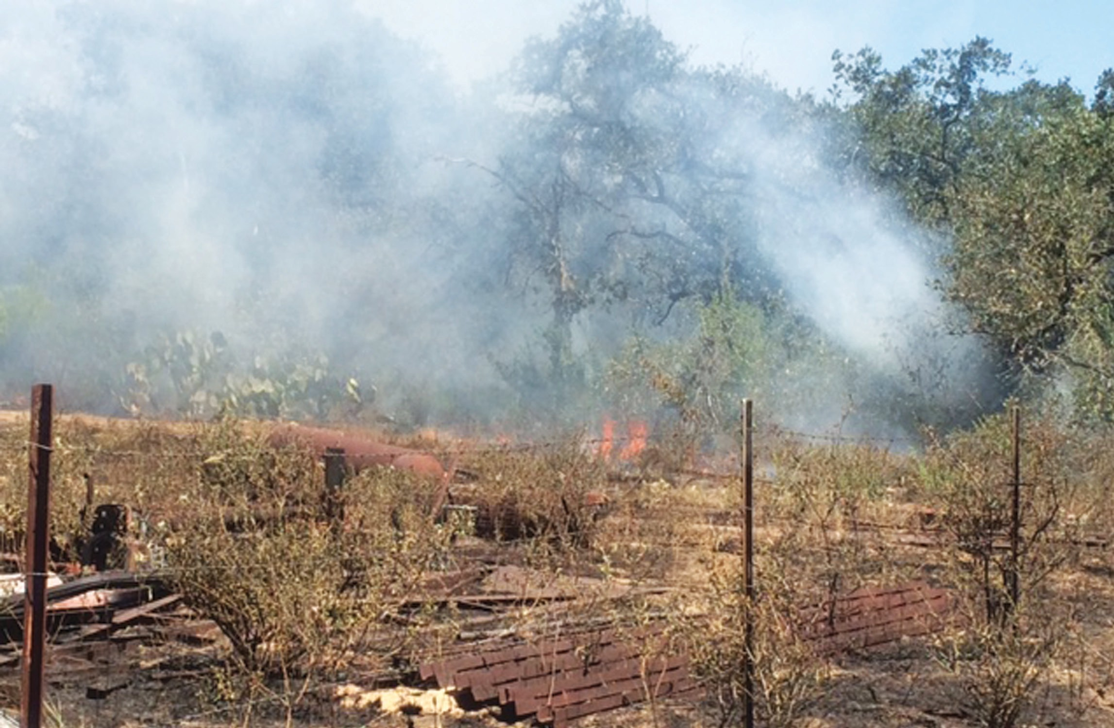 Shortly after four o'clock, Sunday afternoon, Sept. 13, a fire at 780 Quail Meadow Ln., south of Lytle was responded to and eventually created a situation where 375 acres were involved. 21 area fire departments that brought 37 units helped put out the blaze. Fire was 95% contained by about 11:30 p.m. and was completely contained around 2 a.m., Monday morning.