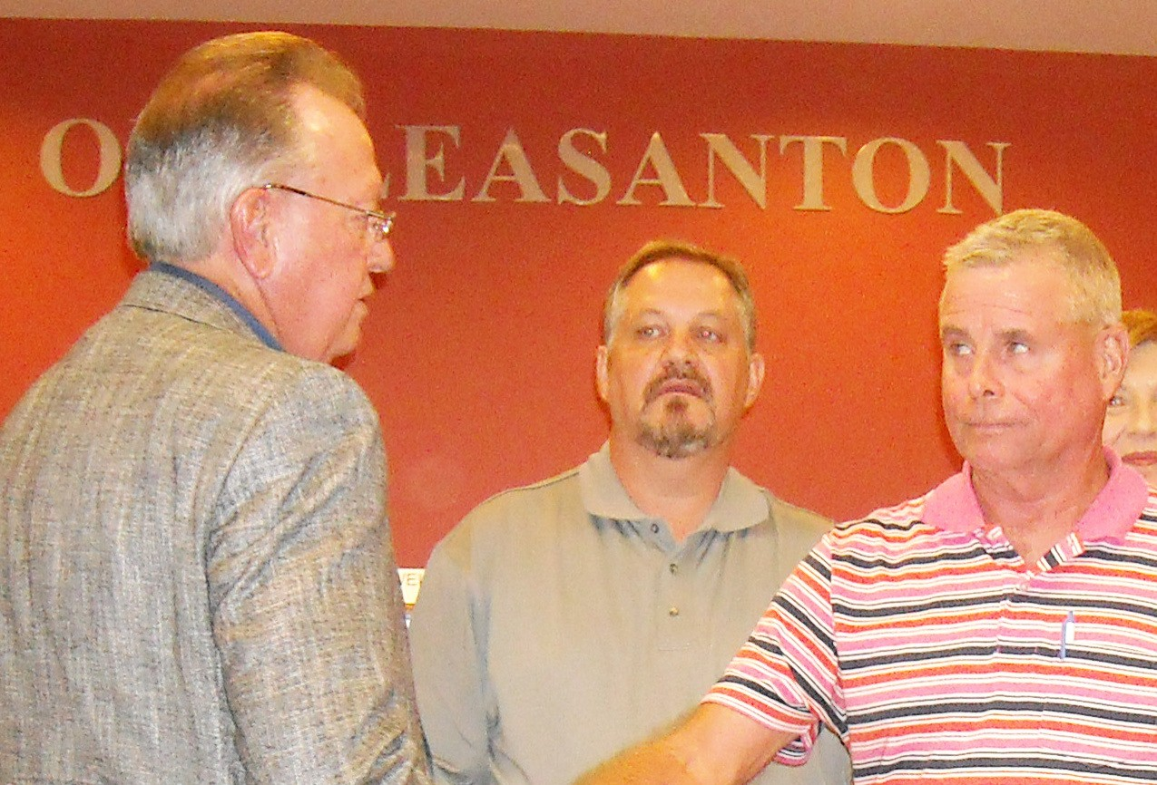 Travis Hall Jr. during a council meeting with Doug Best and David Haley.