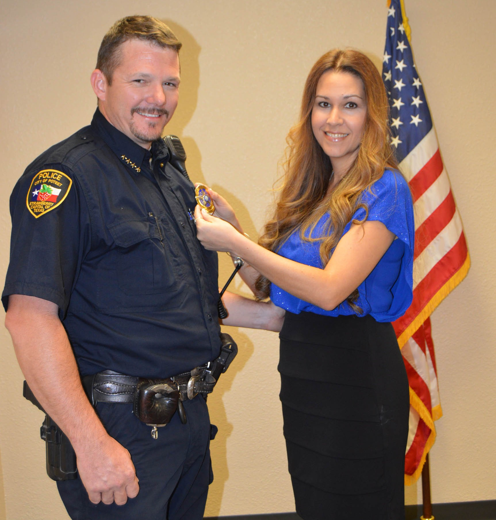 The City of Poteet named Bruce Hickman as their new Chief of Police on Monday, September 14. His wife, Jennifer Wilborn-HIckman helps him pin on his badge during the ceremony held in council chambers. A reception followed. SUE BROWN | PLEASANTON EXPRES
