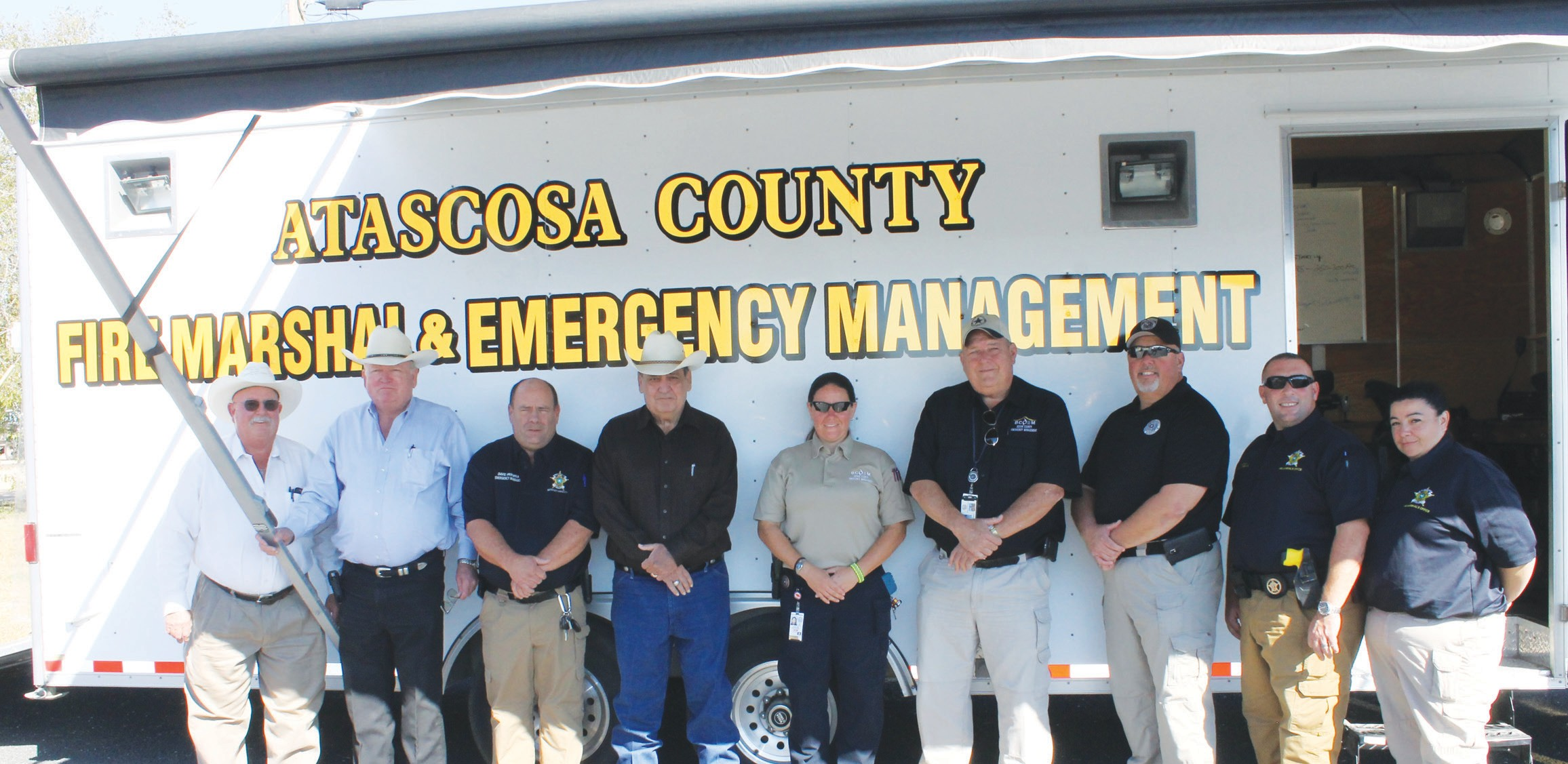 Bexar County Emergency Management Coordinator Kyle Coleman repurposed a combined rehab/ communications trailer to Atascosa County. From left, are Comm. Lonnie Gillespie, Pct. 1; Comm. Bill Carroll, Pct. 4; David Prasifka, Atascosa County Emergency Management Coordinator; Comm. Freddie Ogden, Pct. 3; Tina Neely-Lopez, Bexar County OEM; Kyle Coleman, Bexar County Emergency Manager; Chris Lopez, Bexar County Fire Marshal, Todd Perna, Atascosa County Fire Marshal and Kim Ingram, Reserve MV - Atascosa County FMO