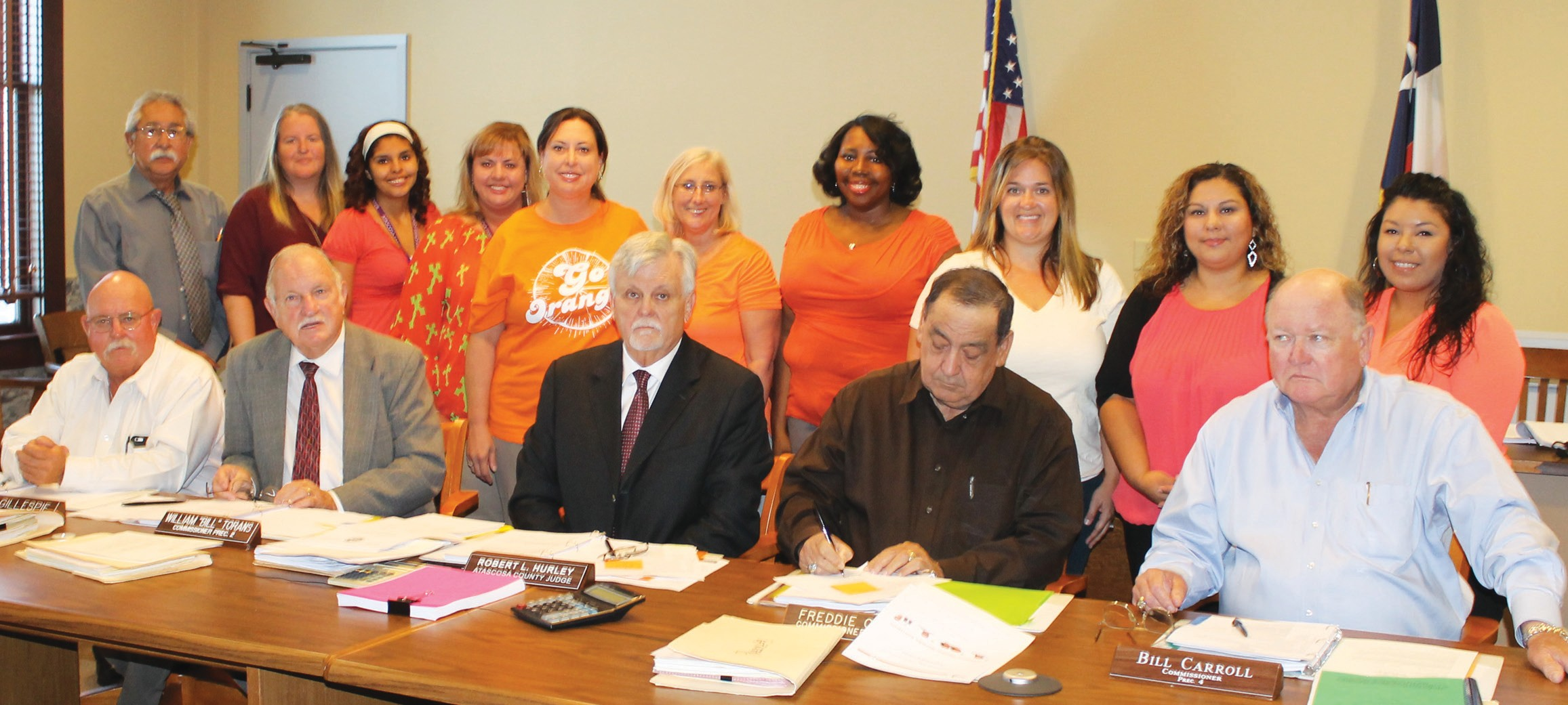 During the September 14 meeting of Commissioners' Court, September was declared '2015 Hunger Action Month'. Standing from left are, Daniel Carbajal, Workforce Solutions; Christi Sanchez; Adrianne Mendez, AFCC; Shawnene Edmondson, AFCC; Stephanie Smith, San Antonio Food Bank; Linda Harper, Wesley Nurse with MHM; Shawauna Marshall, Amy Suvall, Yvette Navarro and Erica Flores, all with BCFS Education Services - Head Start, Atascosa County. Seated are Commissioner Lonnie Gillespie, Pct. 1; Commissioner Bill Torans, Pct. 2; County Judge Bob Hurley; Commissioner Freddie Ogden, Pct. 3 and Bill Carroll, Pct. 4.