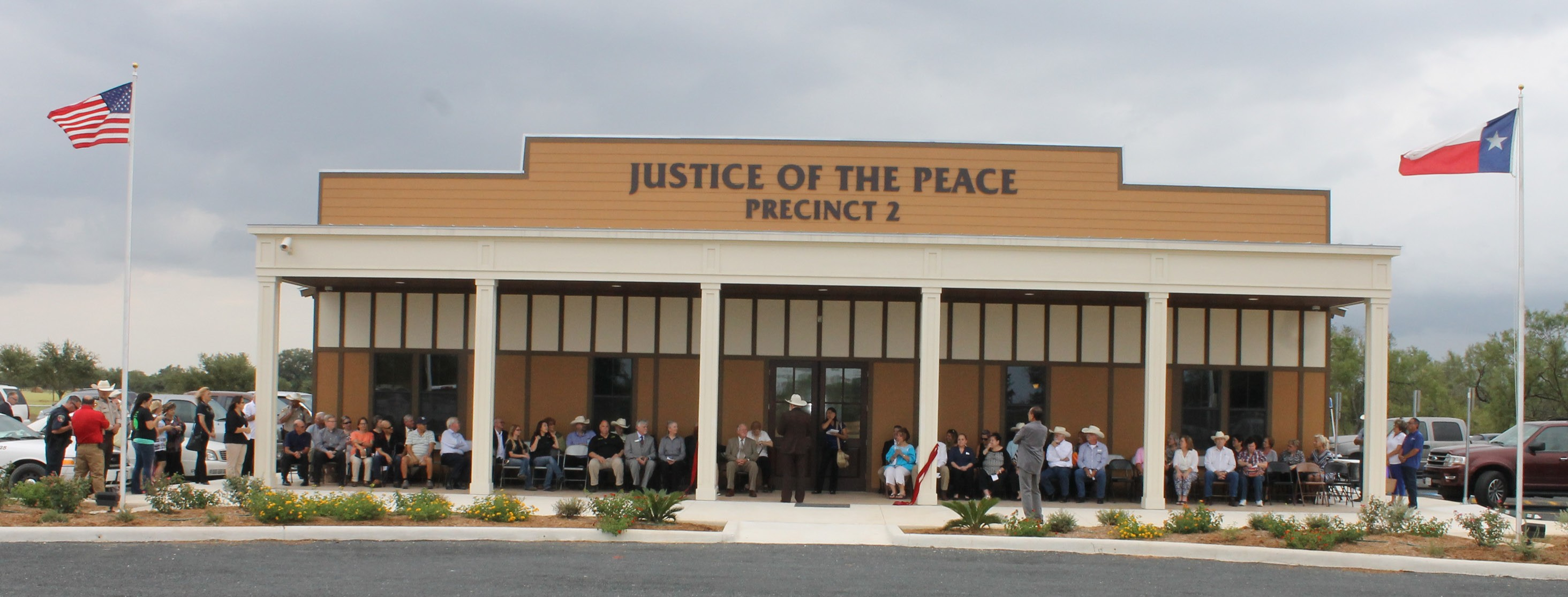 The new Precinct 2 Justice of the Peace building on FM 1375, near Lytle, September 10, prior to ribbon cutting when visiting officials addressed the crowd.