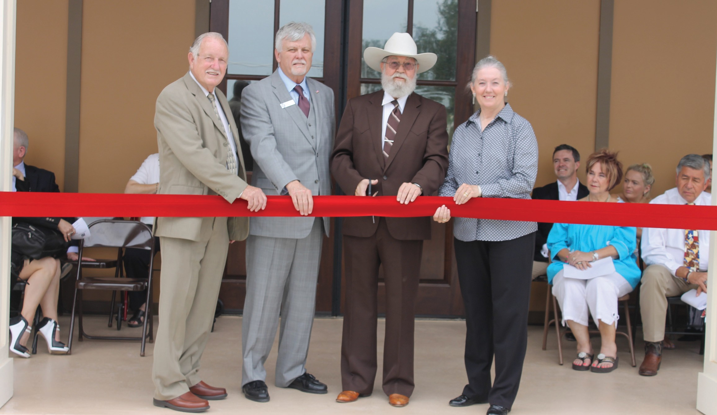 Thursday afternoon, September 10, a ribbon cutting was held for the opening of the new Precinct 2 Justice of the Peace building on FM 1375 east of Lytle. From left are Atascosa County Comissioner Bill Torans, Pct. 2; Atascosa County Judge Bob Hurley, Justice of the Peace Kyle Bradley, Pct. 2; and retired Atascosa County Judge Diana Bautista.