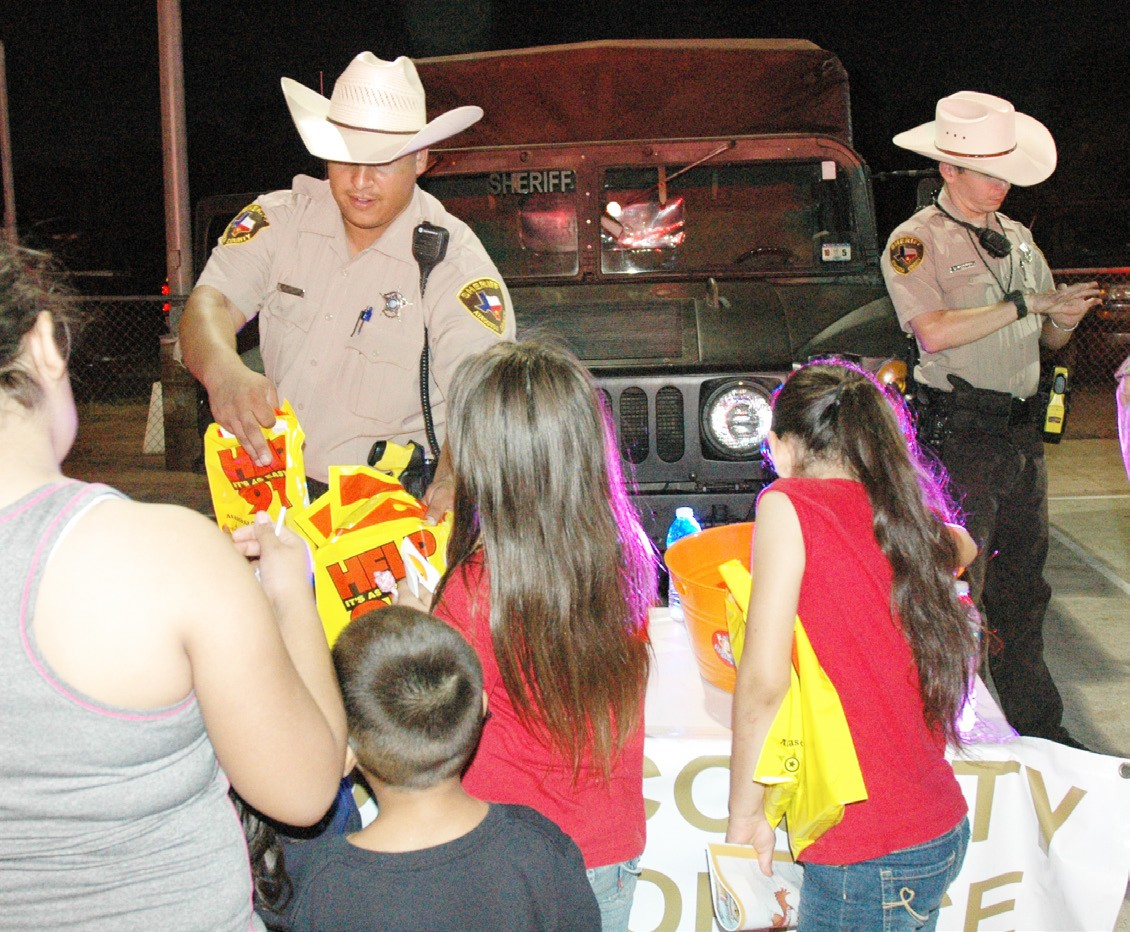 The Sheriff's Departments passed out goodie bags a last year's National Night Out at the River Park in Pleasanton. Be sure and join the local agencies this year on Tuesday, October 6.