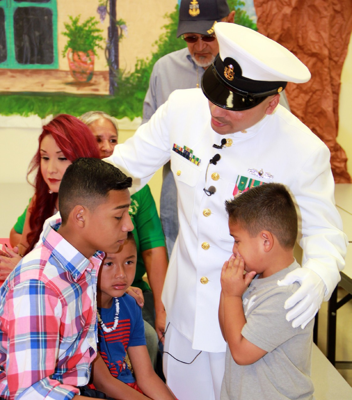 Adrian Macias, 13, Adyn Macias, 7, and Vinny Macias, 6, sons of United States Navy Senior Chief Petty Officer Vincent Macias were surprised Tuesday during lunch at the Pleasanton Primary. The dad returned home to Pleasanton after being deployed for the past 7 months. The boys' mother Amanda Martinez and grandparents Rosie and Camilo Martinez provided the ruse to get the children together at the school.