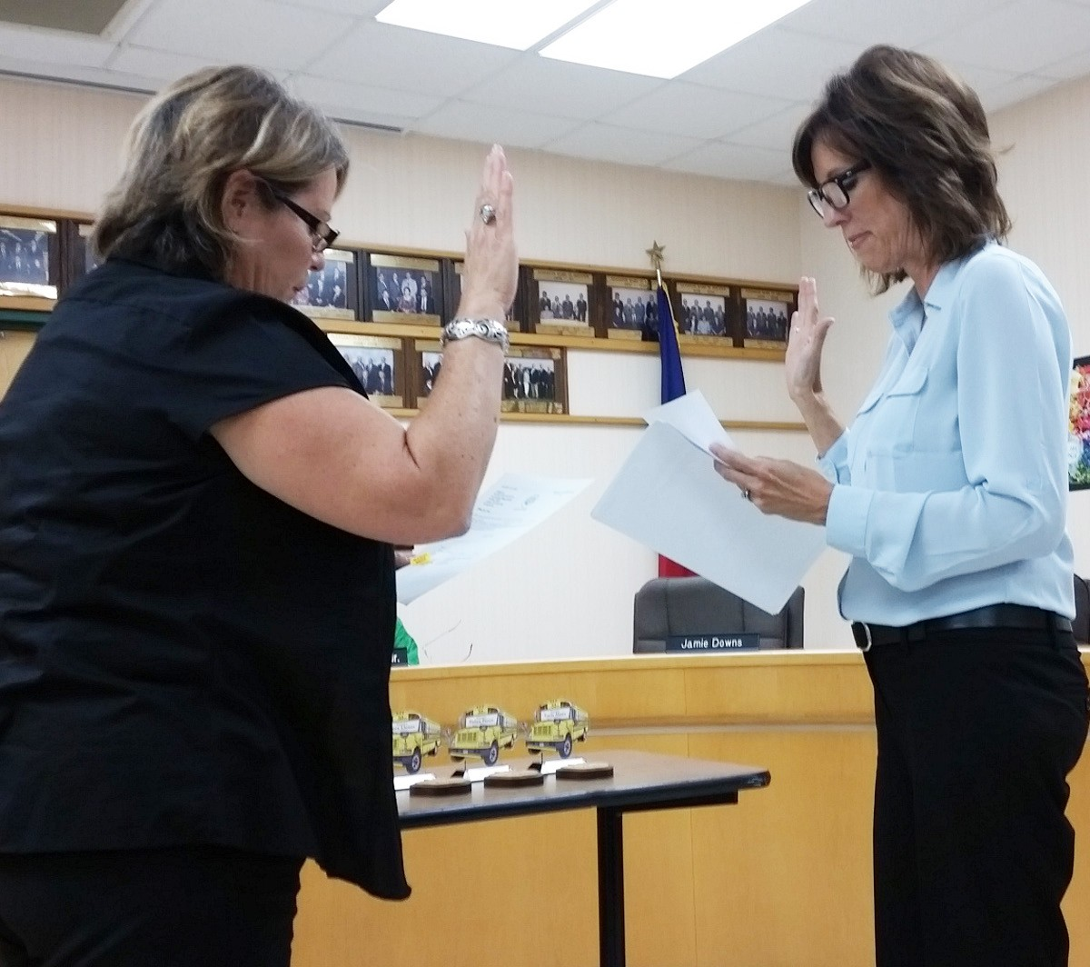 Pat Seay Cox was sworn in as a school board member for PISD by Irma Rodriguez.
