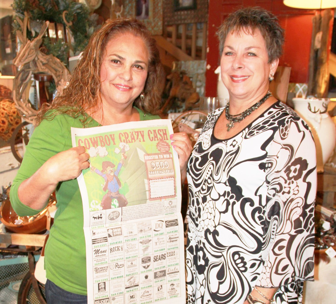 Ninfa Estrada, left, is congratulated by Doris Schorsch of Nest Feathers as the newest winner for Cowboy Crazy Cash. Estrada won a $500 shopping spree to be spent with the participating merchants. Her name was chosen out of thousands of entries.