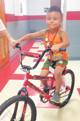 Jourdanton first grader, Alex Gaitan, won this bike for pledging to not do drugs. Alex attends Jourdanton Elementary and is in Mrs. Herrera's class.  The bicycle was donated by the Jourdanton Police Department.