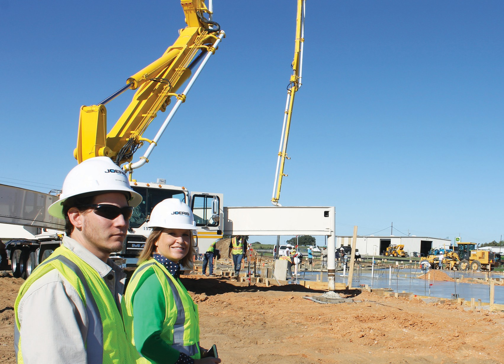 LEON ZABAVA   PLEA SANTON EXPRE Michael McCall, Joeris project manager, and Lorene Tullos, P.I.S.D. director of career and technical education, at the agricultural facility job site.
