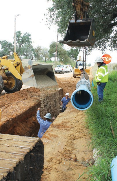 City of Pleasanton work crews under the direction of Doroteo Reyna, utility construction foreman. On Monday, November 30, they're laying 12-inch water main pipe on Haverlah Road at the intersection of Live Oak Street.