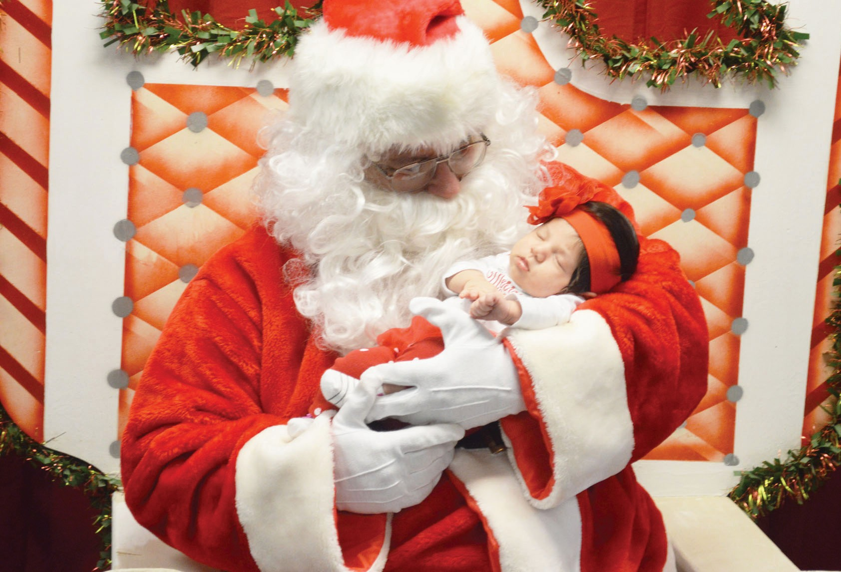 JOE DAVID COR DOVA | Pleasanton Express Little Addyson Martinez has her first visit with Santa Claus. The man in the red suit visited the Jourdanton Library and Civic Center on Monday, December 7 to see all the good boys and girls.