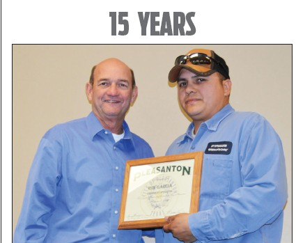 Bruce Pearson presents a certificate to Roy Garcia for his 15 years with the City of Pleasanton. Garcia is an Equipment Operator with the city,